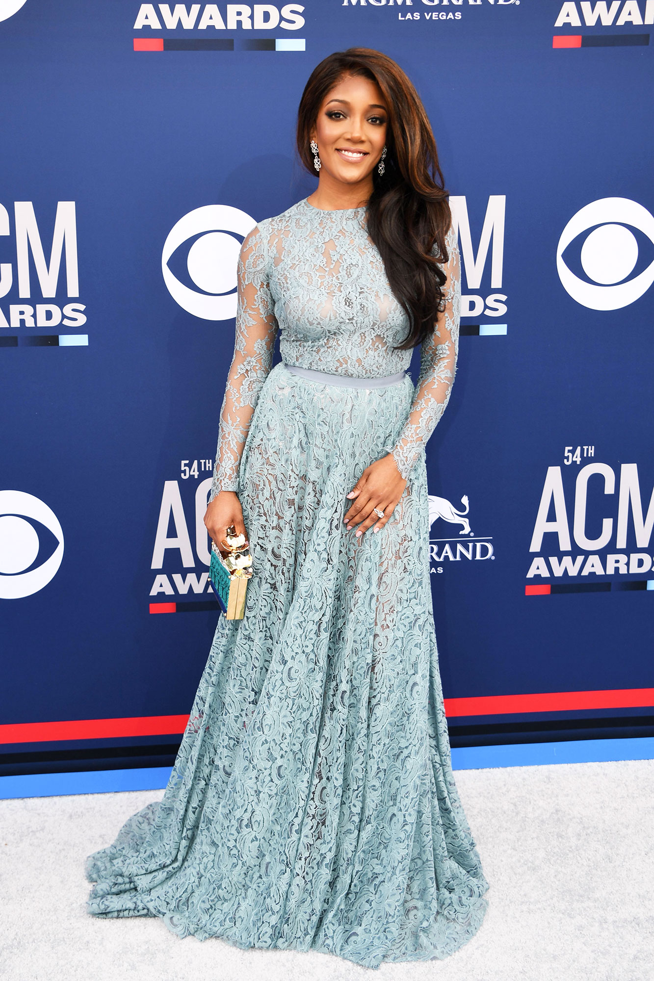 """Mickey Guyton The Best Looks From the Country Music Awards Red Carpet - Making lace a trend, the """"Better Than You Left Me"""" songstress wore a powder blue frock that was to die for."""