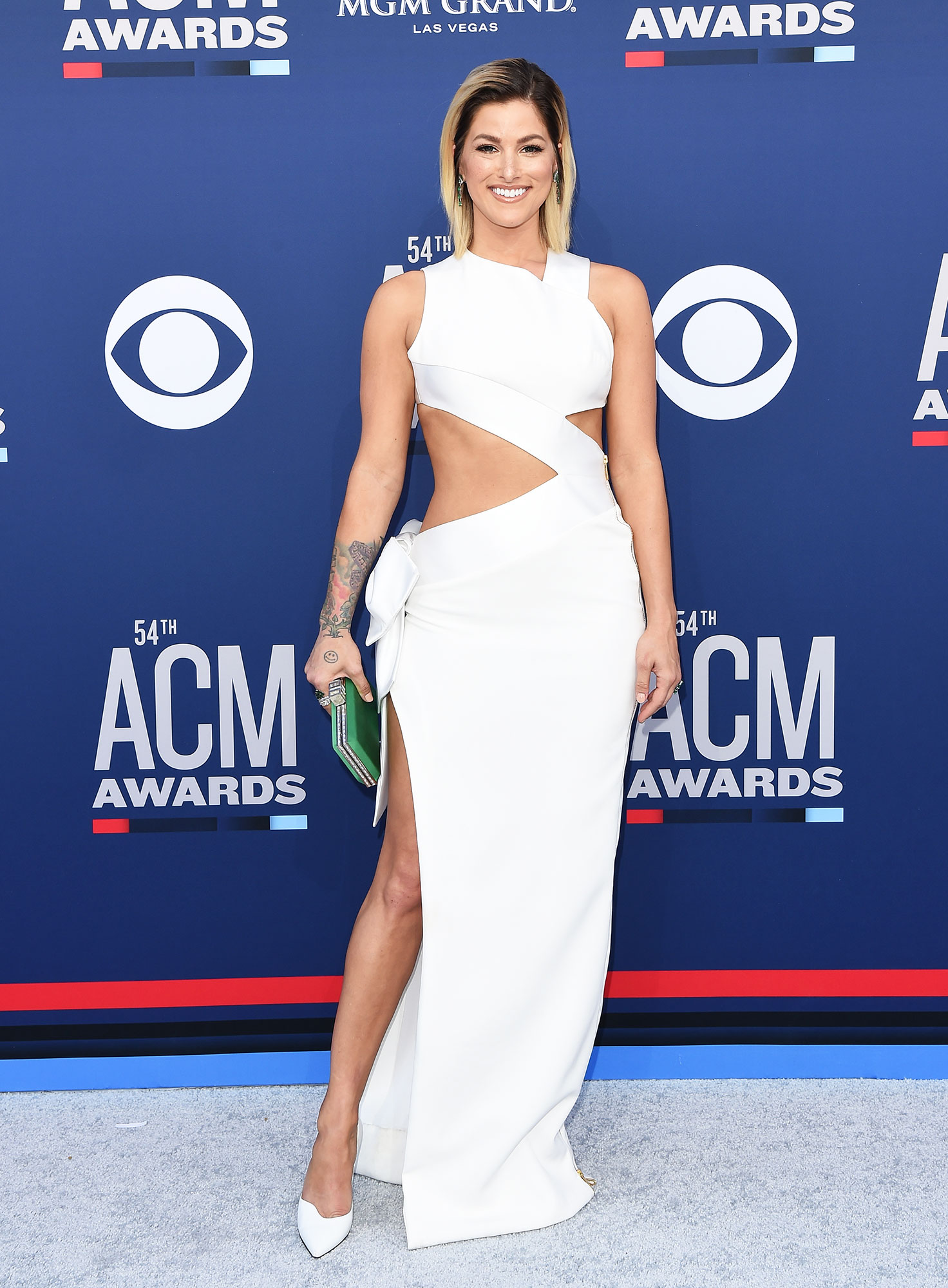 """Cassadee Pope The Best Looks From the Country Music Awards Red Carpet - In an all-white number, the """"Think of You"""" singer's dress featured sexy but classy cutouts."""