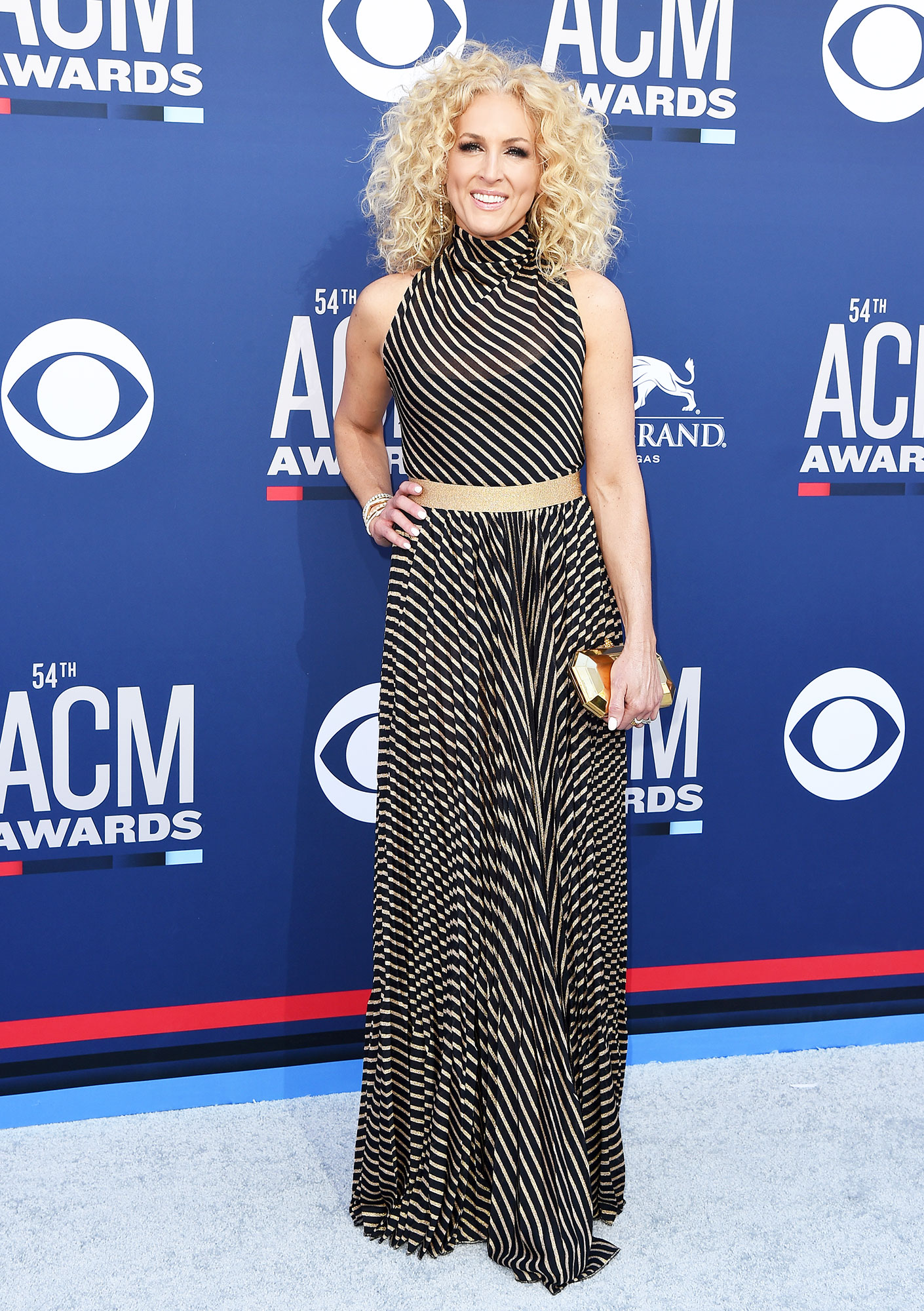 Kimberly Schlapman The Best Looks From the Country Music Awards Red Carpet - The Little Big Town frontwoman wore a black and white striped floor-length dress that was simply gorgeous.