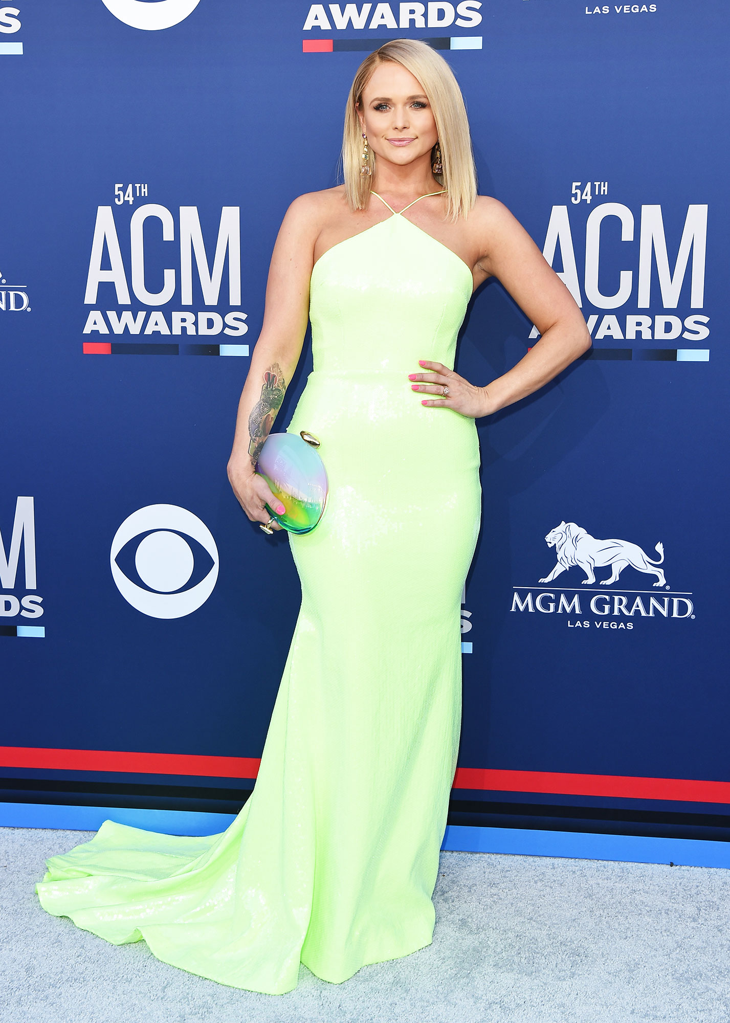 """Miranda Lambert The Best Looks From the Country Music Awards Red Carpet - """"The Man"""" singer stunned in a sleek lime green halter dress with pointy purple heels to top it off."""