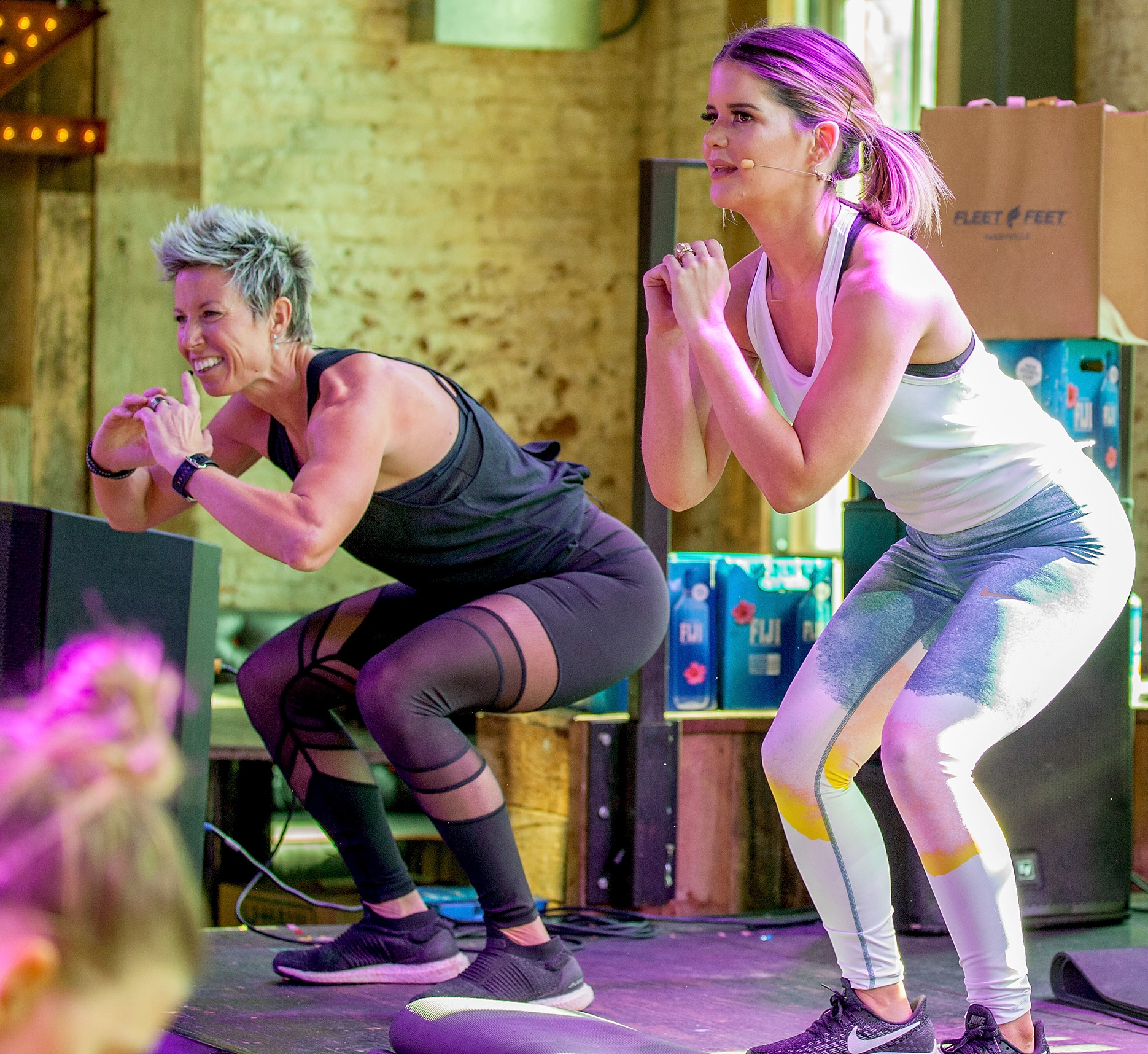 Erin-Oprea,-Maren-Morris-working-out - Erin Oprea and Maren Morris work out onstage during CMA Brunch and Burn at Dierks Bentley's Whiskey Row on November 10, 2018 in Nashville, Tennesse