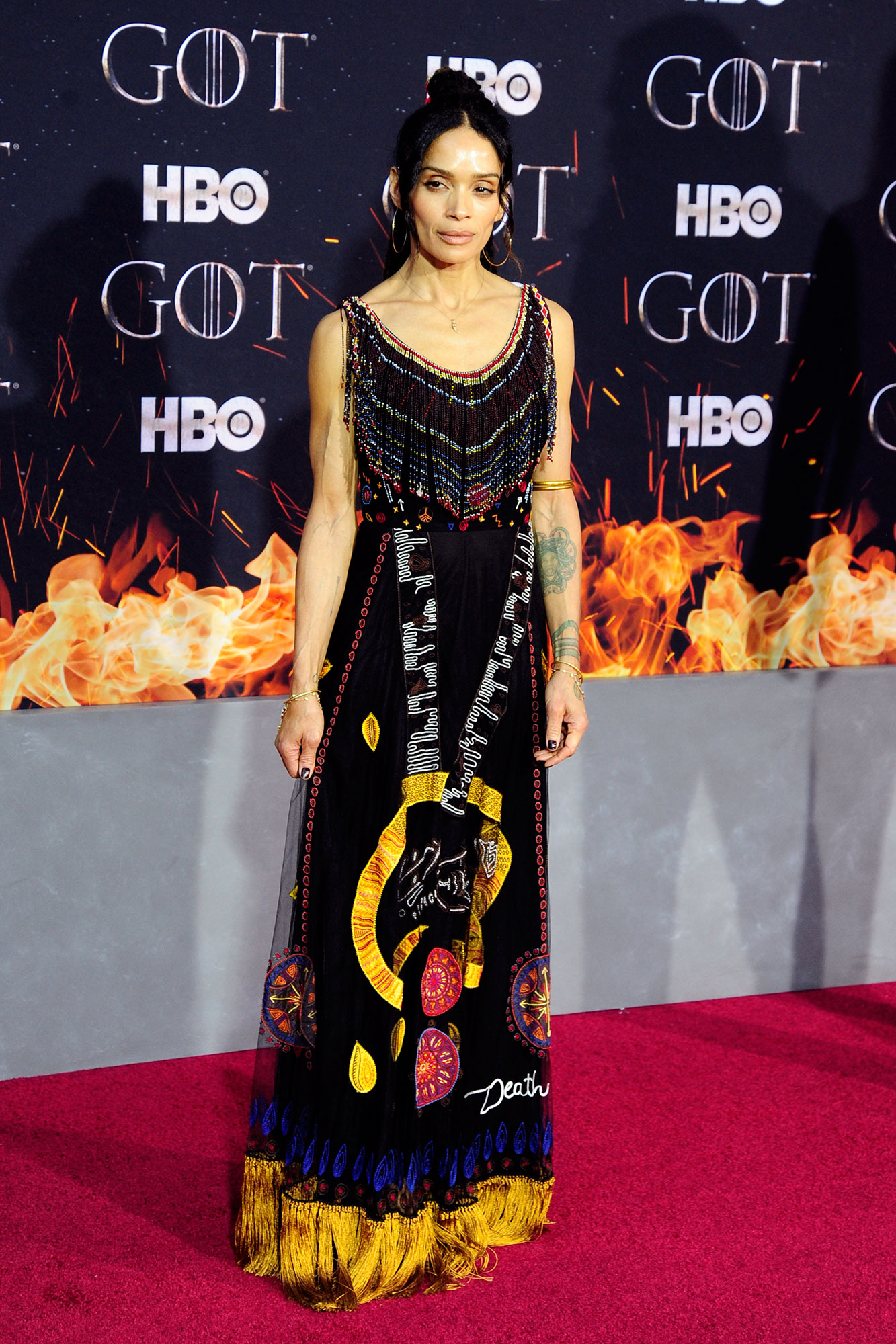 Lisa Bonet Game Of Thrones - Wearing a skeleton- and snake-adorned fringe Dior gown.