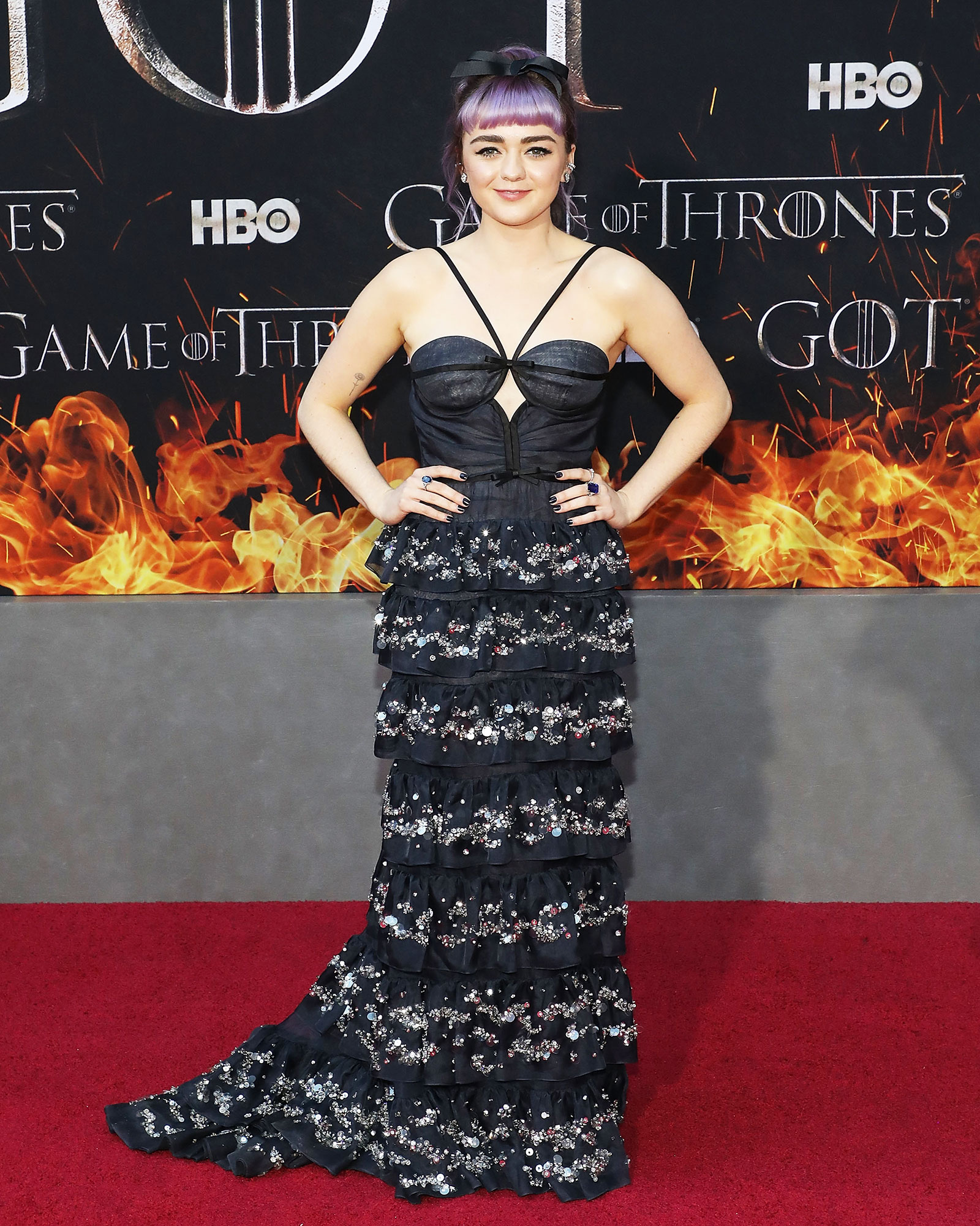 Maisie Williams game of thrones - Wearing a crystal-embellished tiered Miu Miu number with her new purple hair.