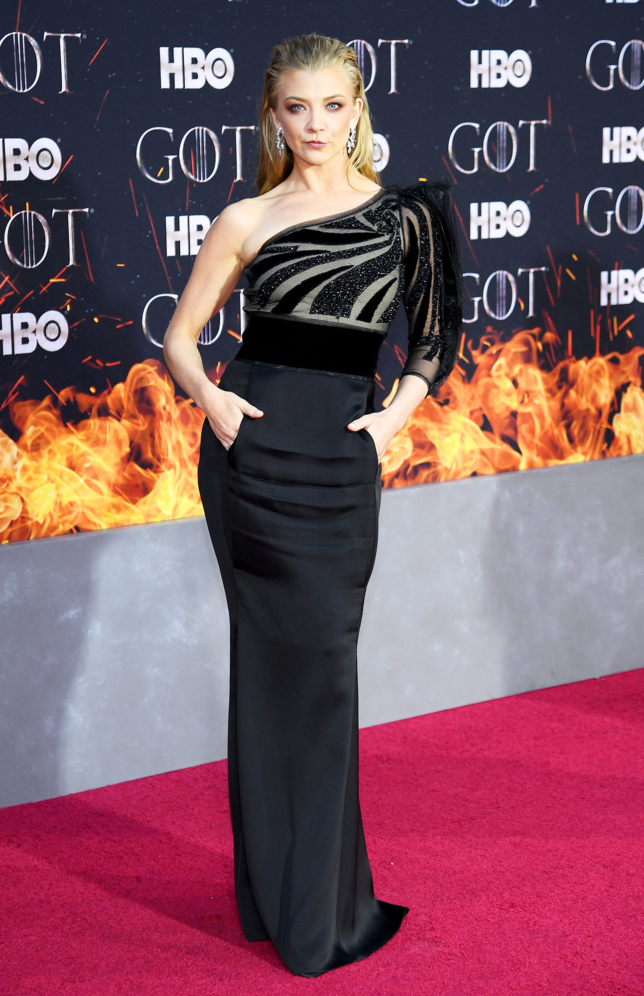 Natalie Dormer game of thrones - Wearing a one-shoulder Giorgio Armani column gown with pockets.
