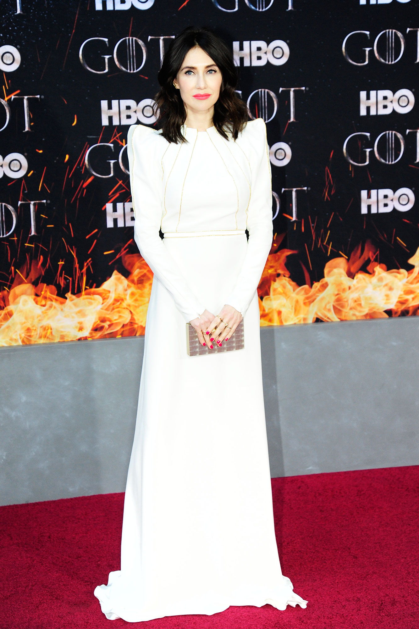 Carice van Houten game of thrones - Wearing a white Ronald Van Der Kemp floor-length gown with puff sleeves.