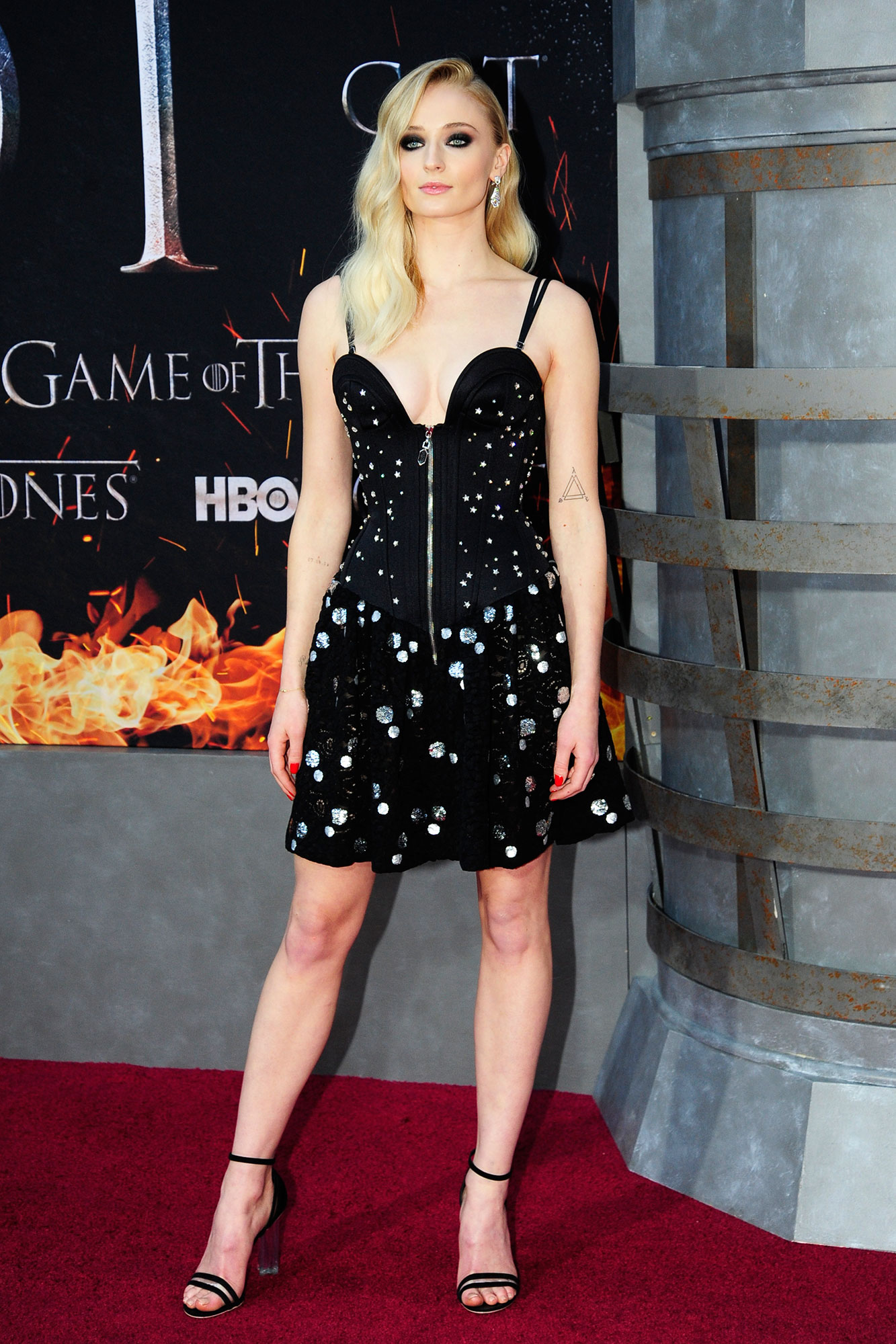 Sophie Turner game of thrones - Wearing a sparkly Louis Vuitton minidress with strappy sandals.