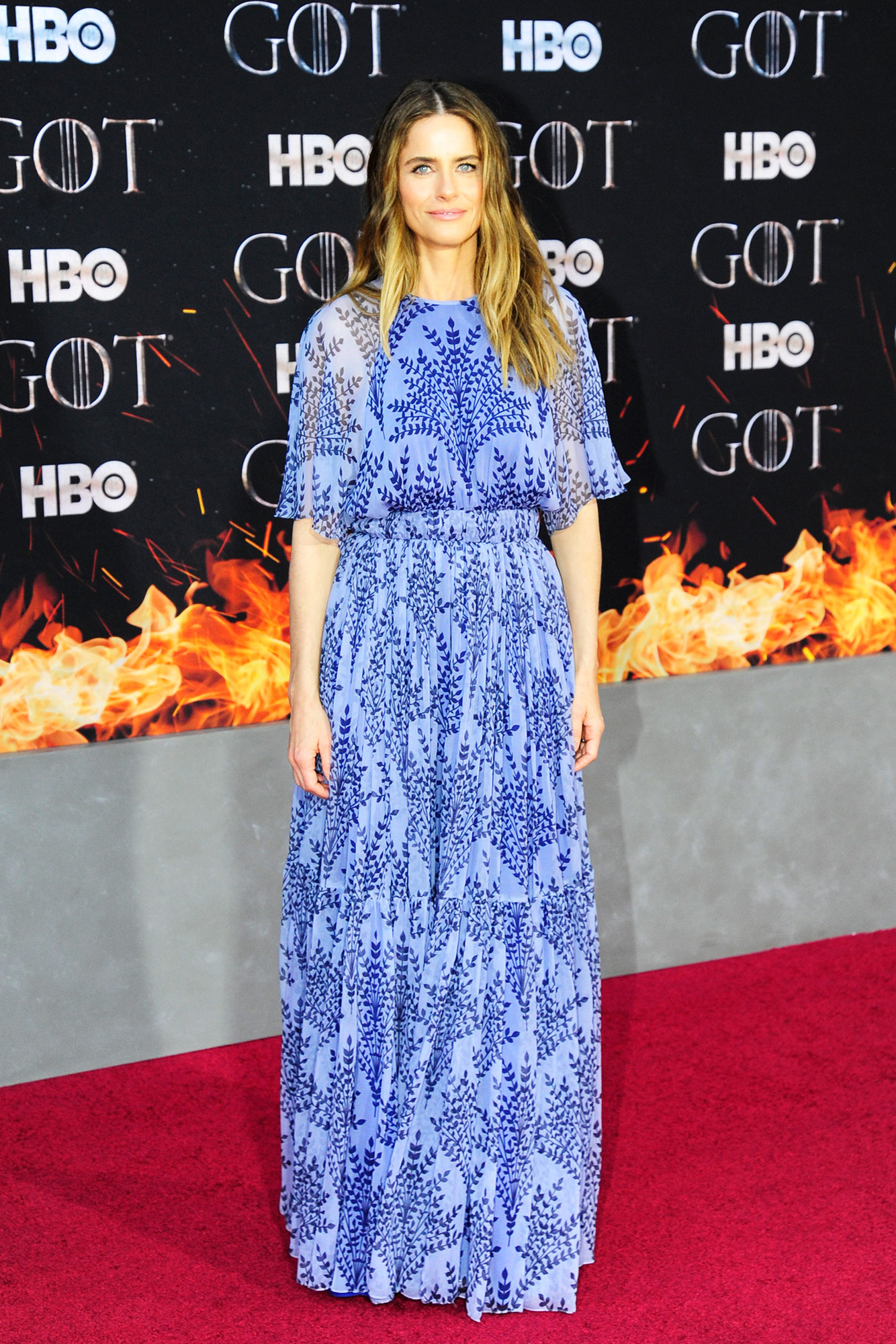 Amanda Peet game of thrones - Wearing a short-sleeve Carolina Herrera gown that Meghan Markle wore during her trip to Morocco with Prince Harry earlier this year.
