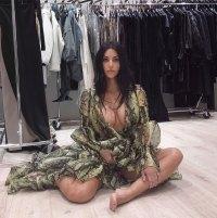 Kim Kardashian fittings snakeskin pattern dress