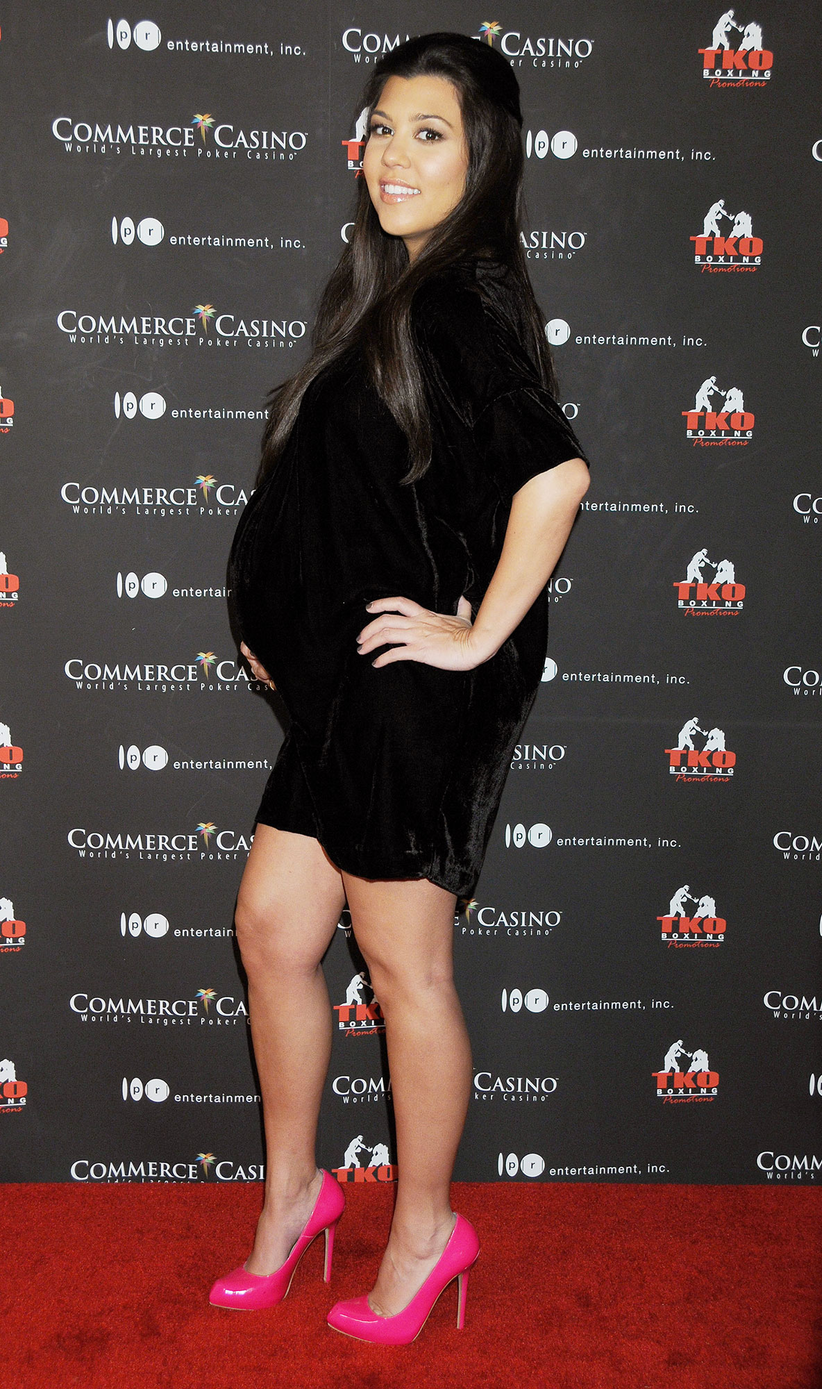 Happy 40th Birthday, Kourtney Kardashian - Putting her burgeoning bump (she was pregnant with her first son, Mason, at the time) and legs on display, the mom-to-be rocked a velvet mini and neon pink heels at a charity event.