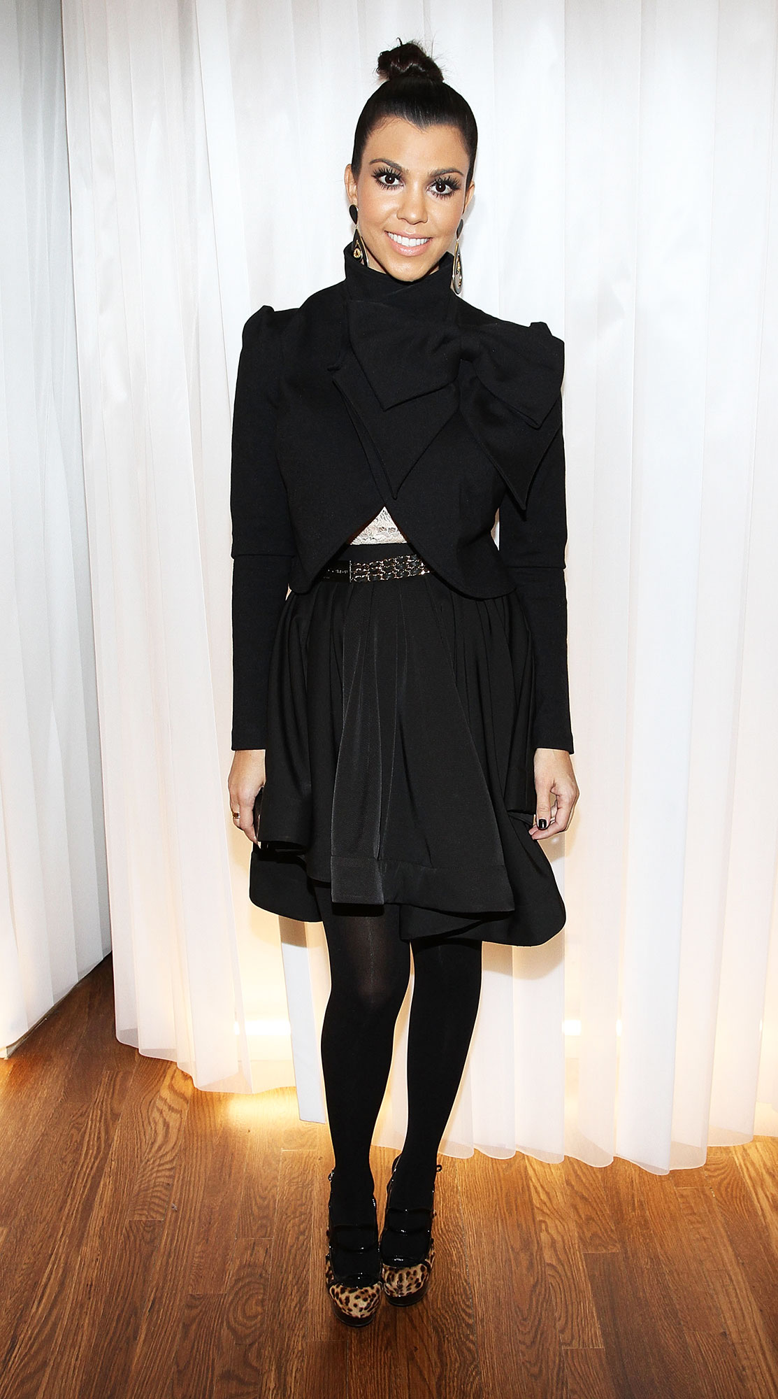 Happy 40th Birthday, Kourtney Kardashian - It was all about the black for the reality star in a Funktional black miniskirt and blazer at the opening of the NYC DASH boutique.