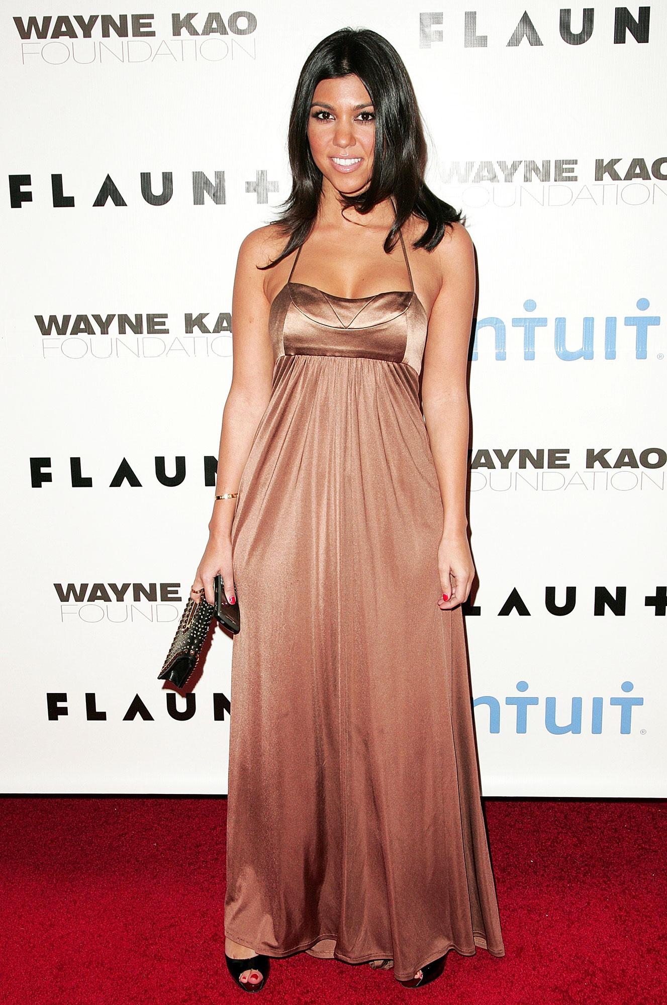 Happy 40th Birthday, Kourtney Kardashian - She was a golden goddess in a bronze Doo Ri empire-waist gown at a Flaunt magazine party.