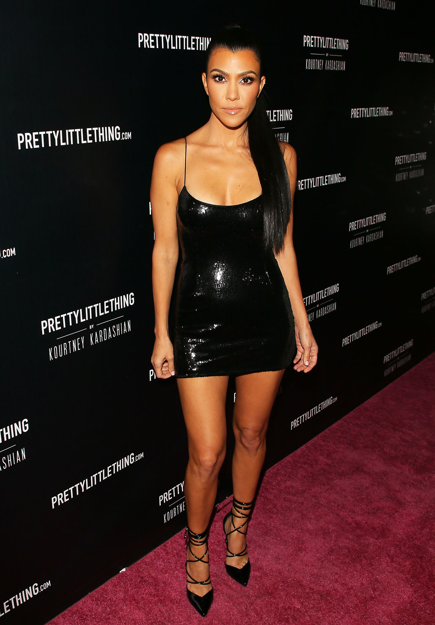 Happy 40th Birthday, Kourtney Kardashian - The brunette beauty showed some leg in a shiny LBD from her PrettyLittleThing collection at a launch event for the collab.