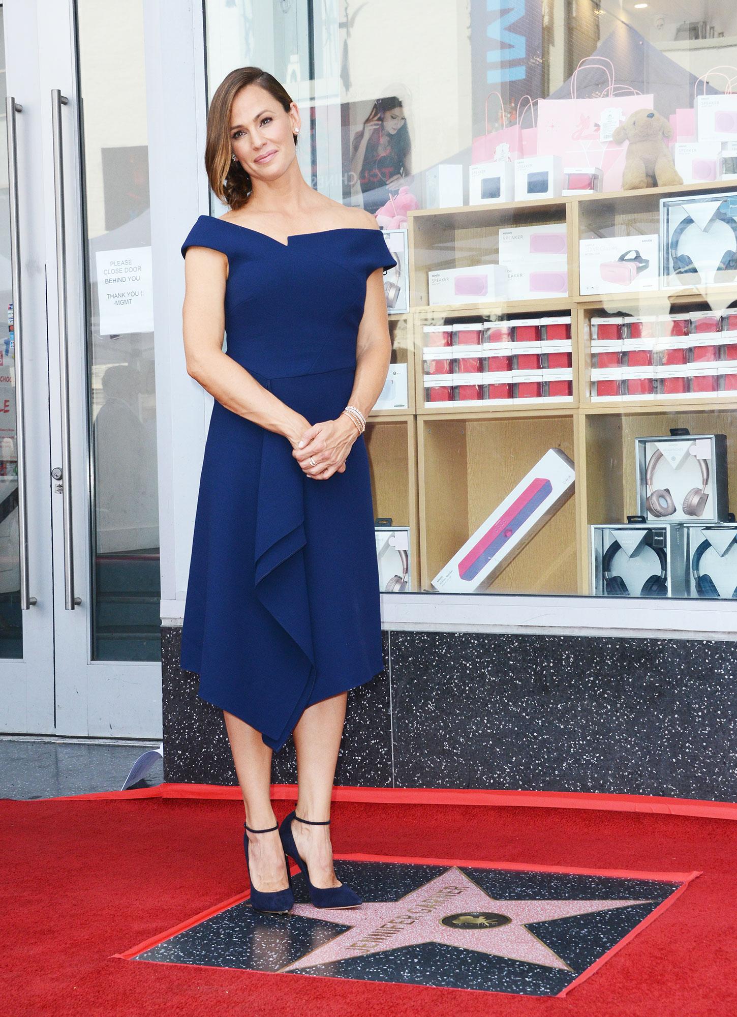 Jennifer Garner navy blue dress walk of fame hollywood - Actress Jennifer Garner Honored With Star On The Hollywood Walk Of Fame held on August 20, 2018 in Hollywood, California.