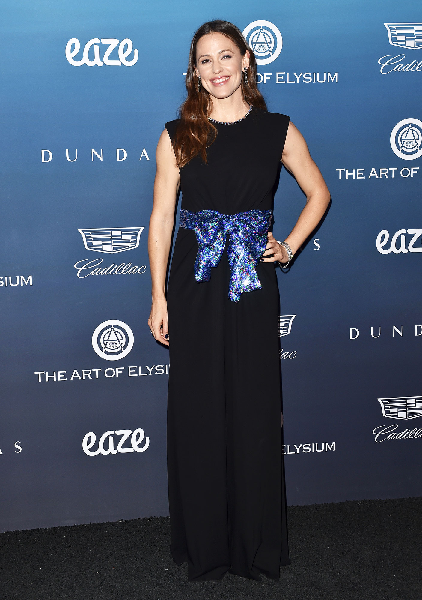 Jennifer Garner black dress glitter belt The Art of Elysium's 12th Annual Celebration - Heaven - The actress added a bit of sparkle to her black jumpsuit with a blue sequined bow at the 2019 Art of Elysium Celebration in L.A.