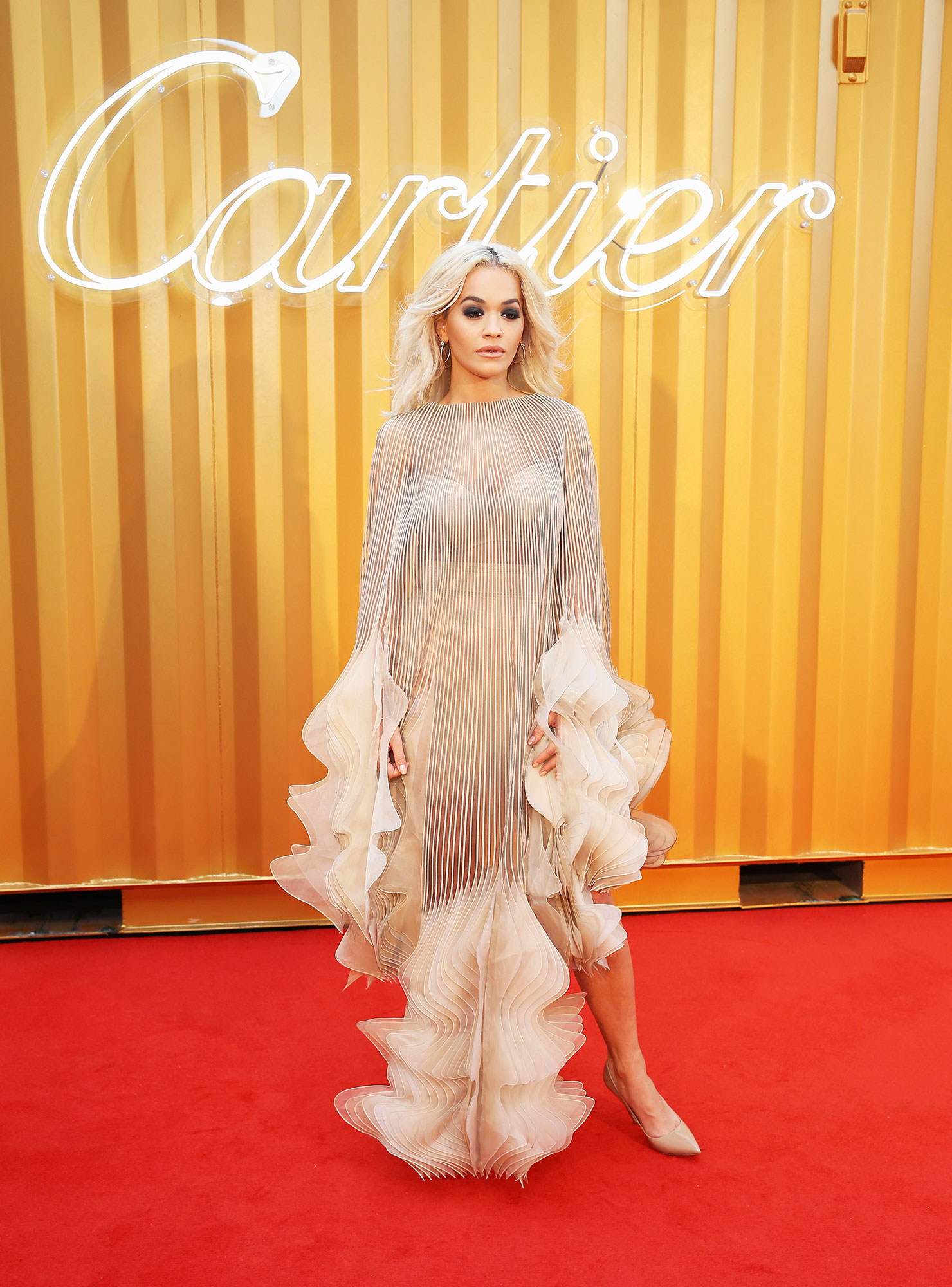 Iris van Herpen Rita Ora - In hundreds of layers of dyed nude organza on Nov. 29.