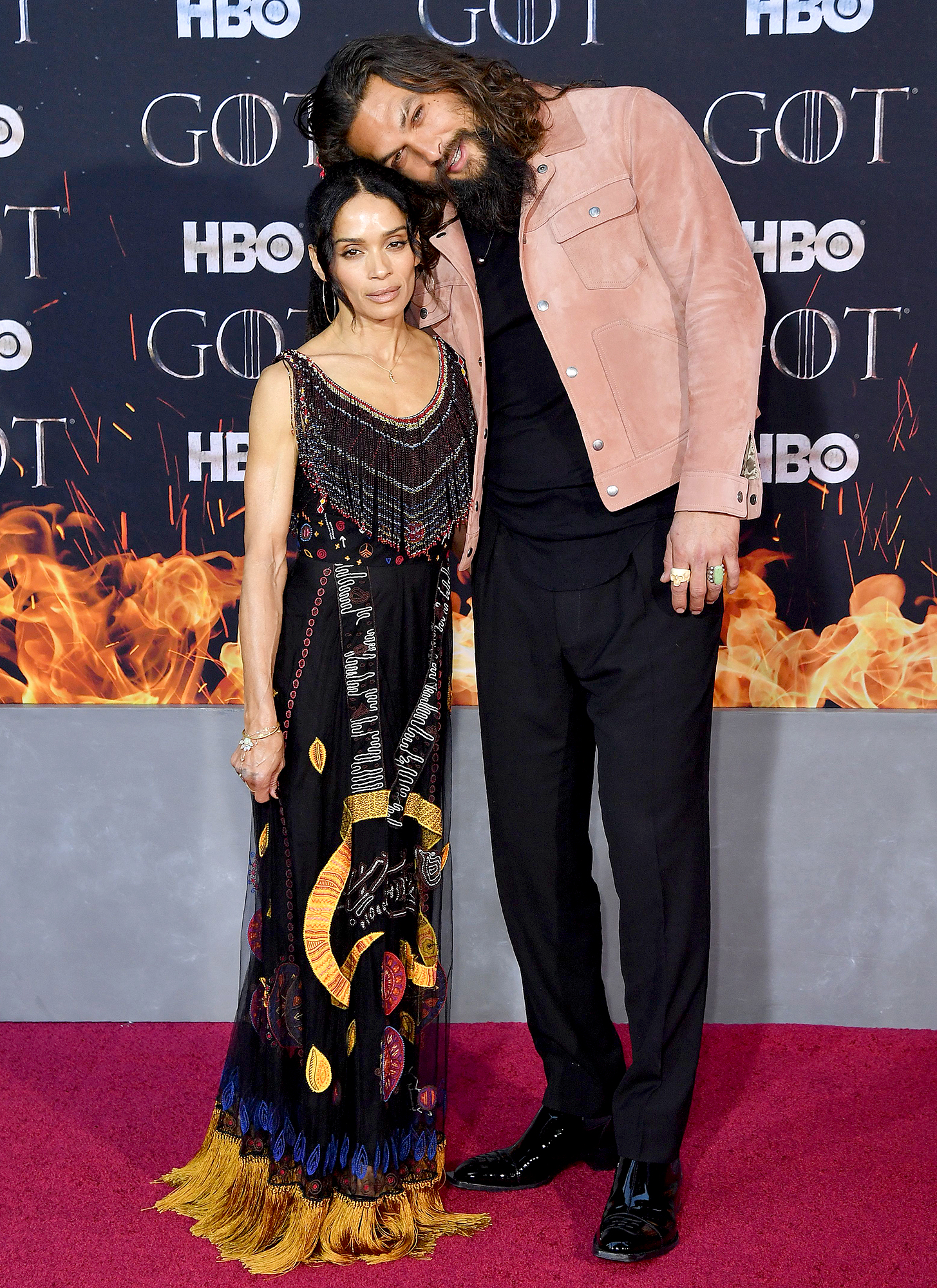 Jason-Momoa-Lisa-Bonet-game-of-thrones - The couple's love continued to show when they hit the red carpet at the GoT premiere. The duo posed as they stood in front of photographers and Momoa even leaned over to be closer to Bonet's height.