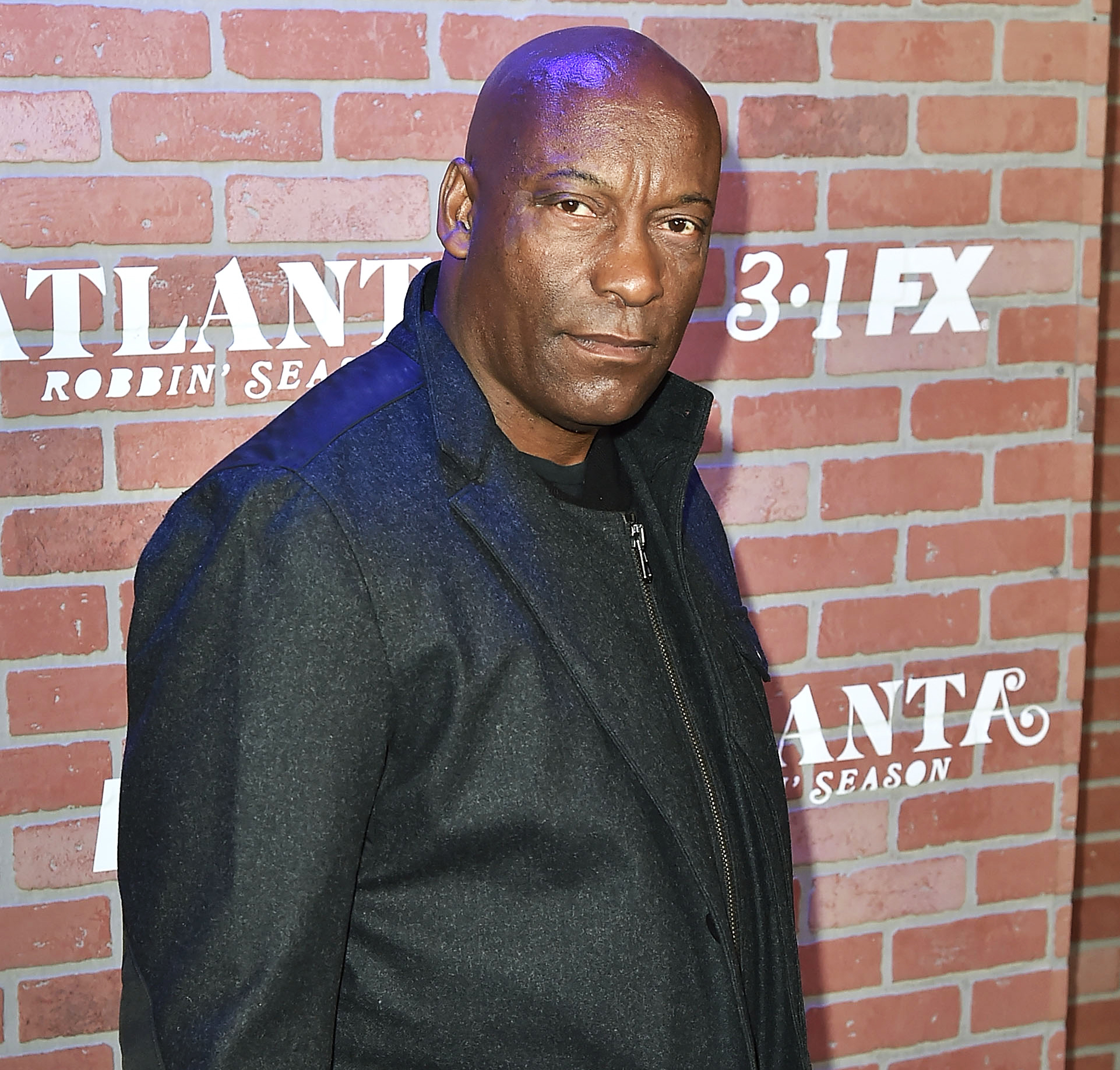 John-Singleton-death-reactions - Mourning the loss of a film pioneer. Celebrities including Samuel L. Jackson and Rose McGowan took to social media to remember director John Singleton after he died at the age of 51 on Monday, April 29.