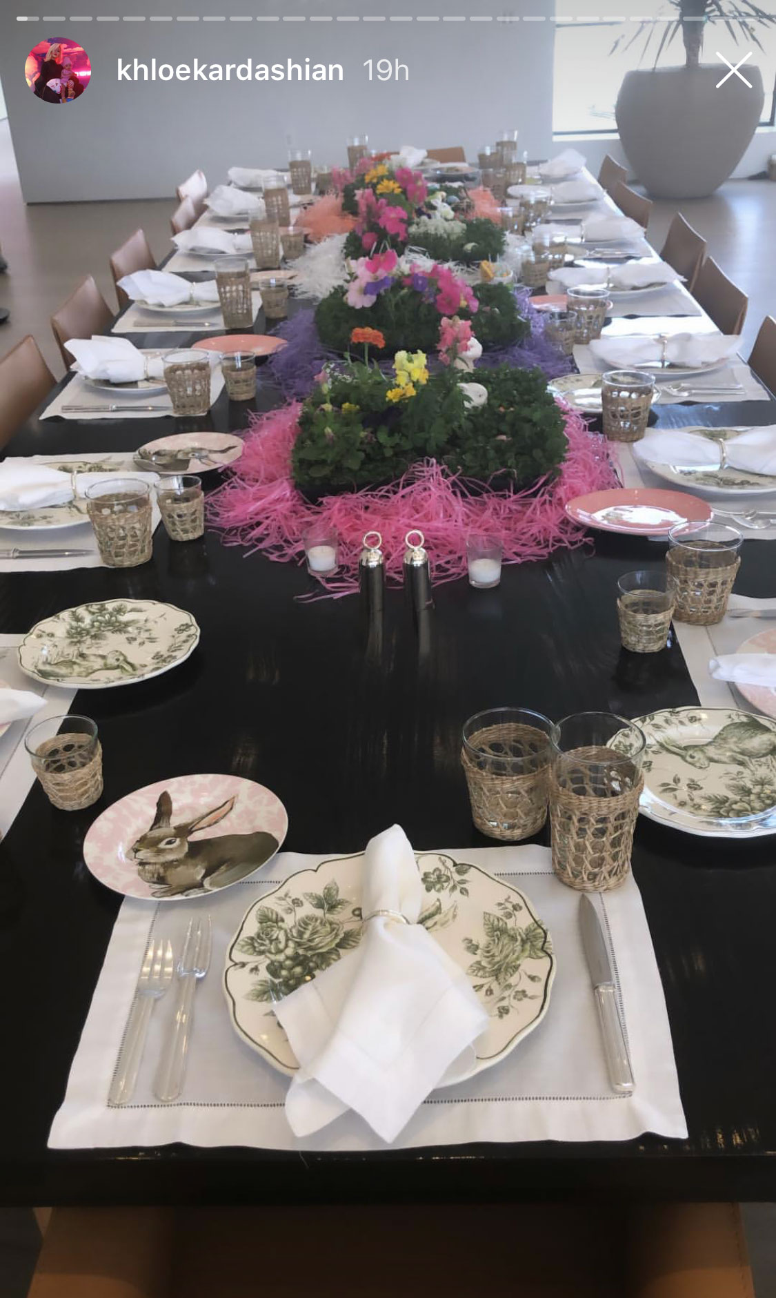 Kardashian Easter - The table was set with bunny plates and Easter-themed centerpieces.