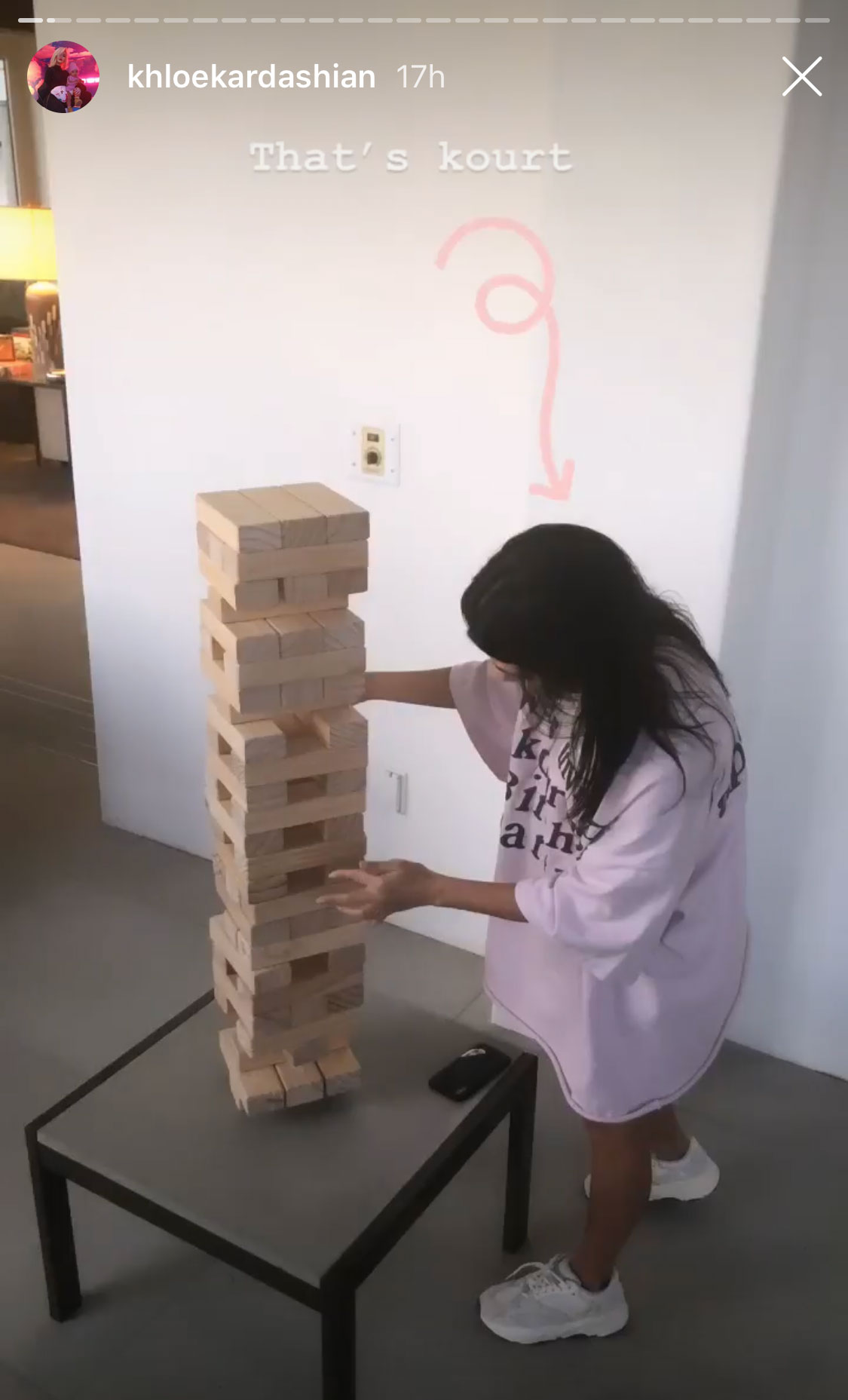 Kourtney Kardashian Kardashian Easter - Khloé shared a photo of Kourtney who was dwarfed by what looked like a huge Jenga game.
