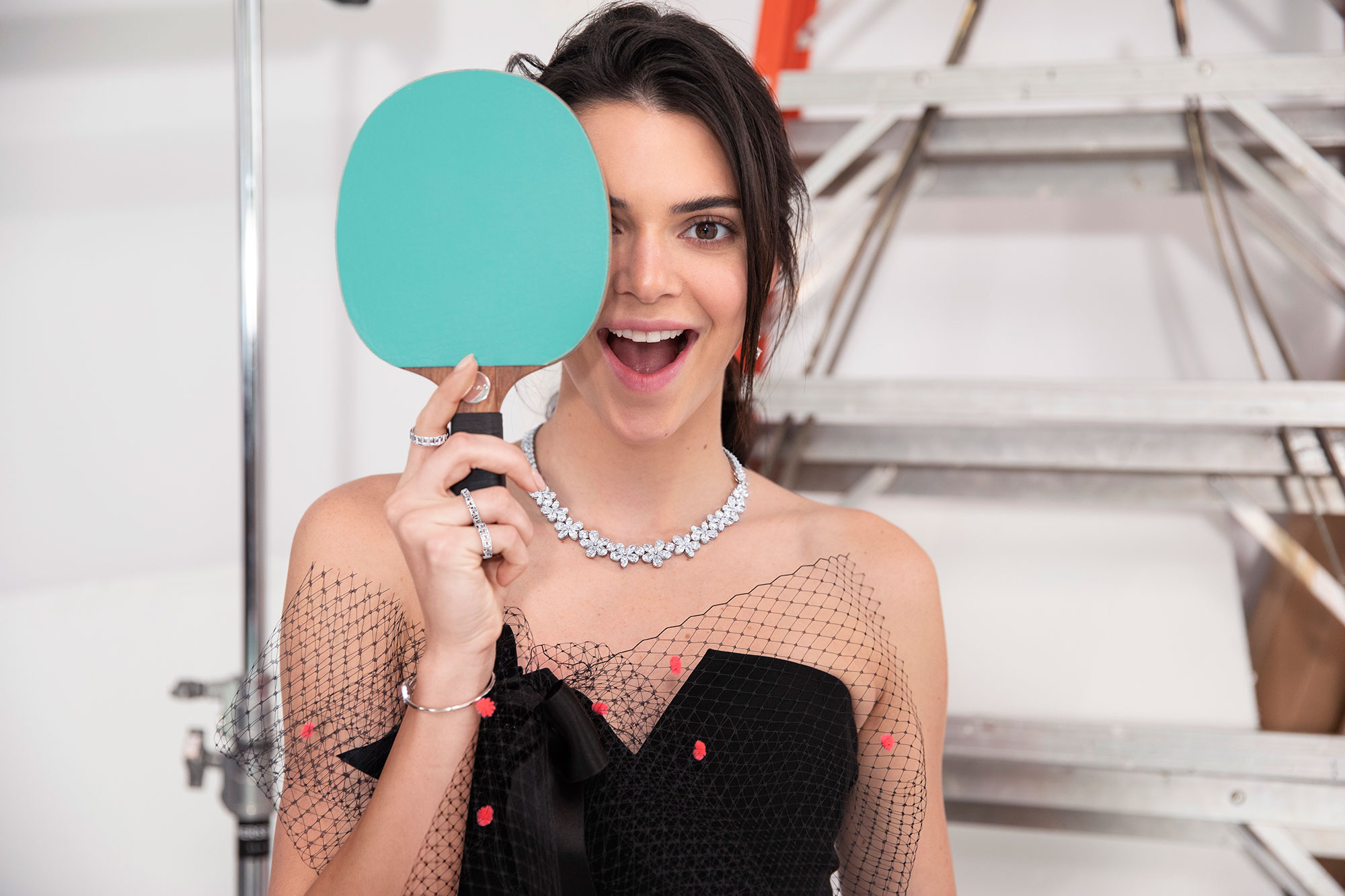 Kendall Jenner Tiffany & Co. Spring Campaign Diamonds - Taking a break from a match, the Tiffany-blue paddle covers half her face, making the giant diamond necklace stand out even more.