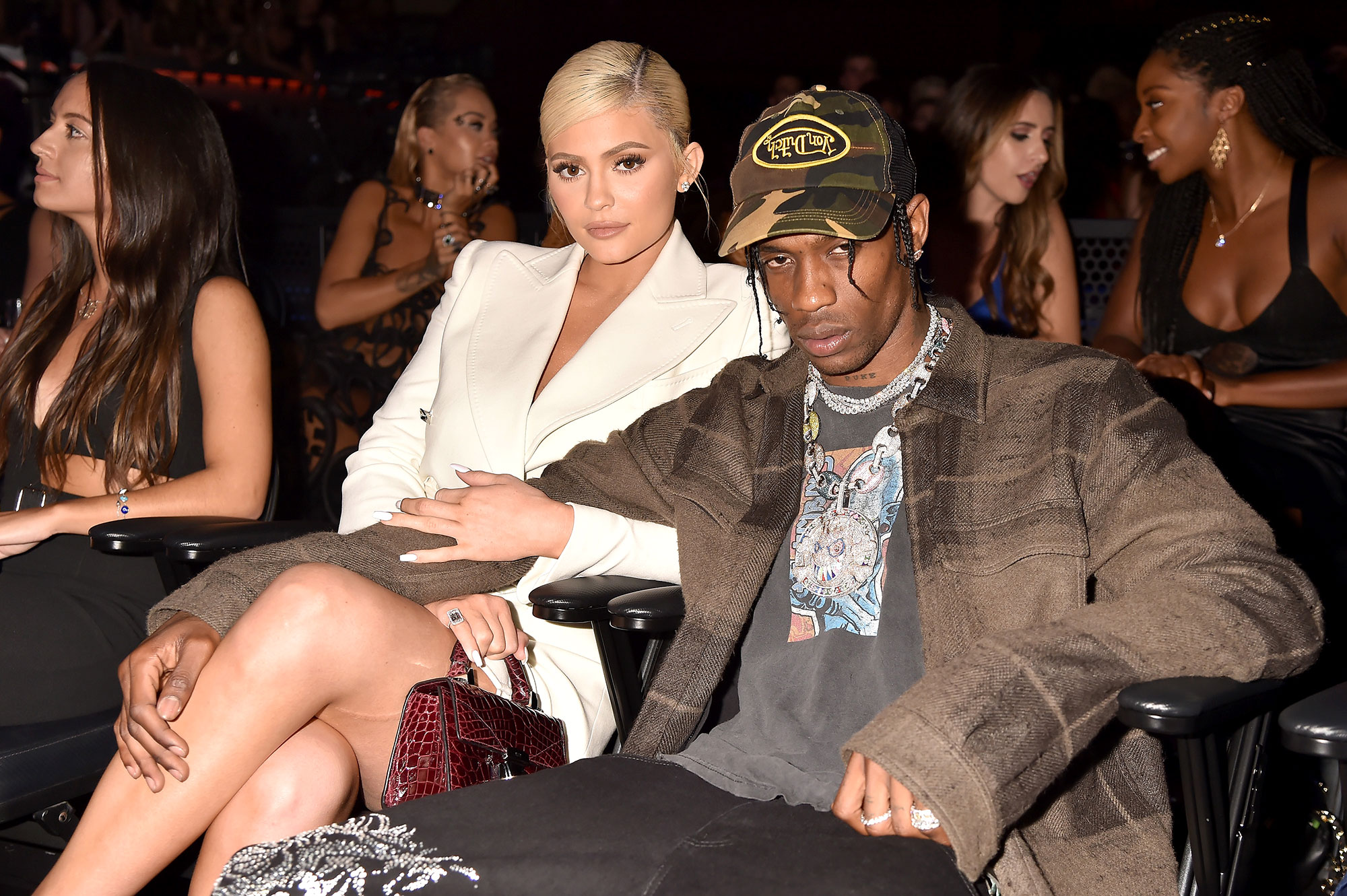 """Kylie and Travis Sweetest Quotes - The """"STARGAZING"""" crooner commented on an Instagram photo of Jenner in a white off-the-shoulder dress with thigh-high cowboy boots. """"Meal not a snack,"""" he wrote."""
