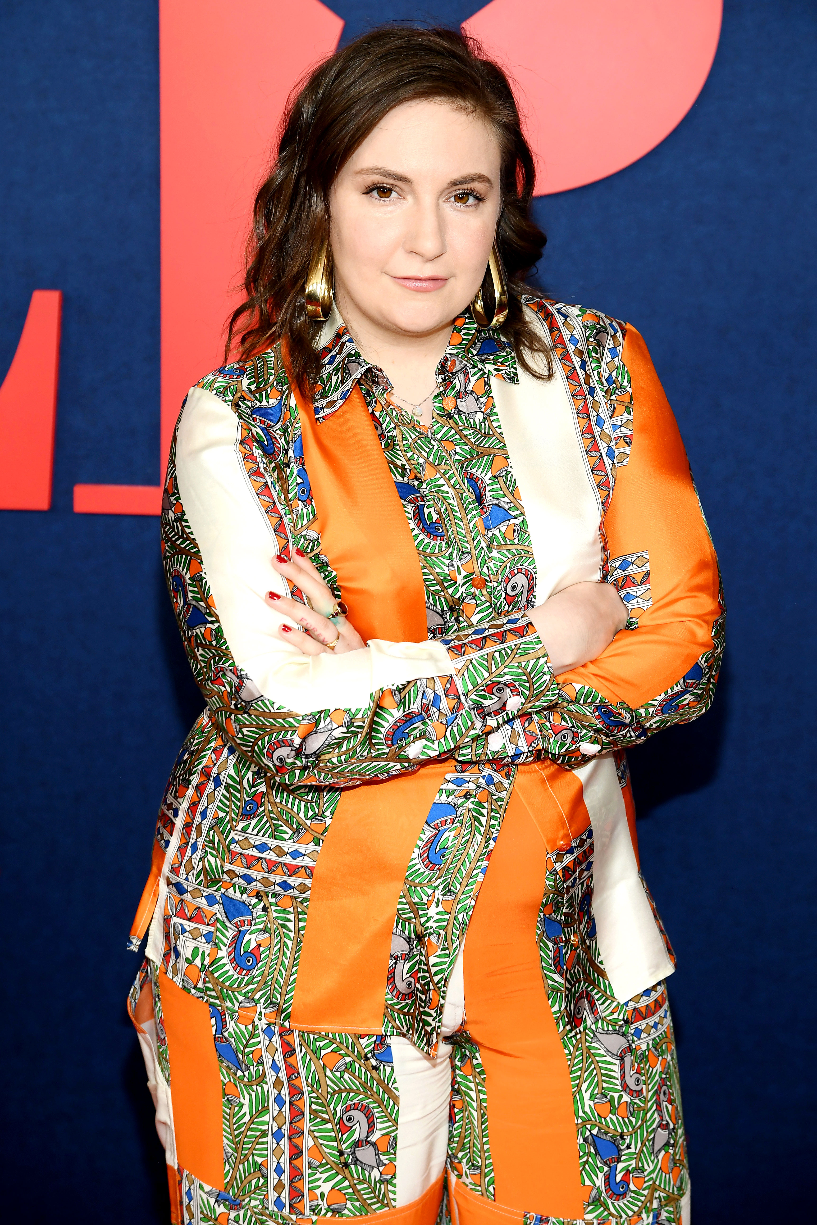 "Lena Dunham Gets Neck Tattoo of What She's 'Most Scared of Being Called' - Lena Dunham attends the ""Veep"" Season 7 premiere at Alice Tully Hall, Lincoln Center on March 26, 2019 in New York City."
