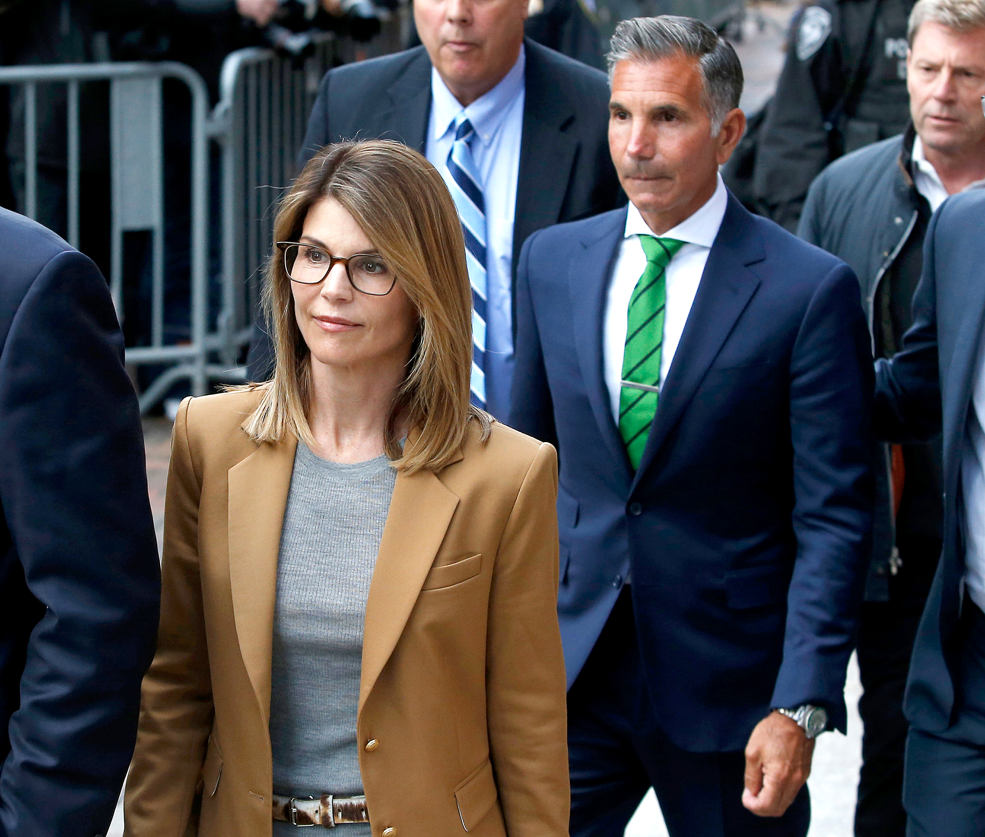 Lori-Loughlin-and-Mossimo-Giannulli-court - The couple appeared at the John Joseph Moakley United States Courthouse in Boston on April 3, 2019. The Full House alum appeared chipper, smiling as she exited a van in a tan-colored suit.