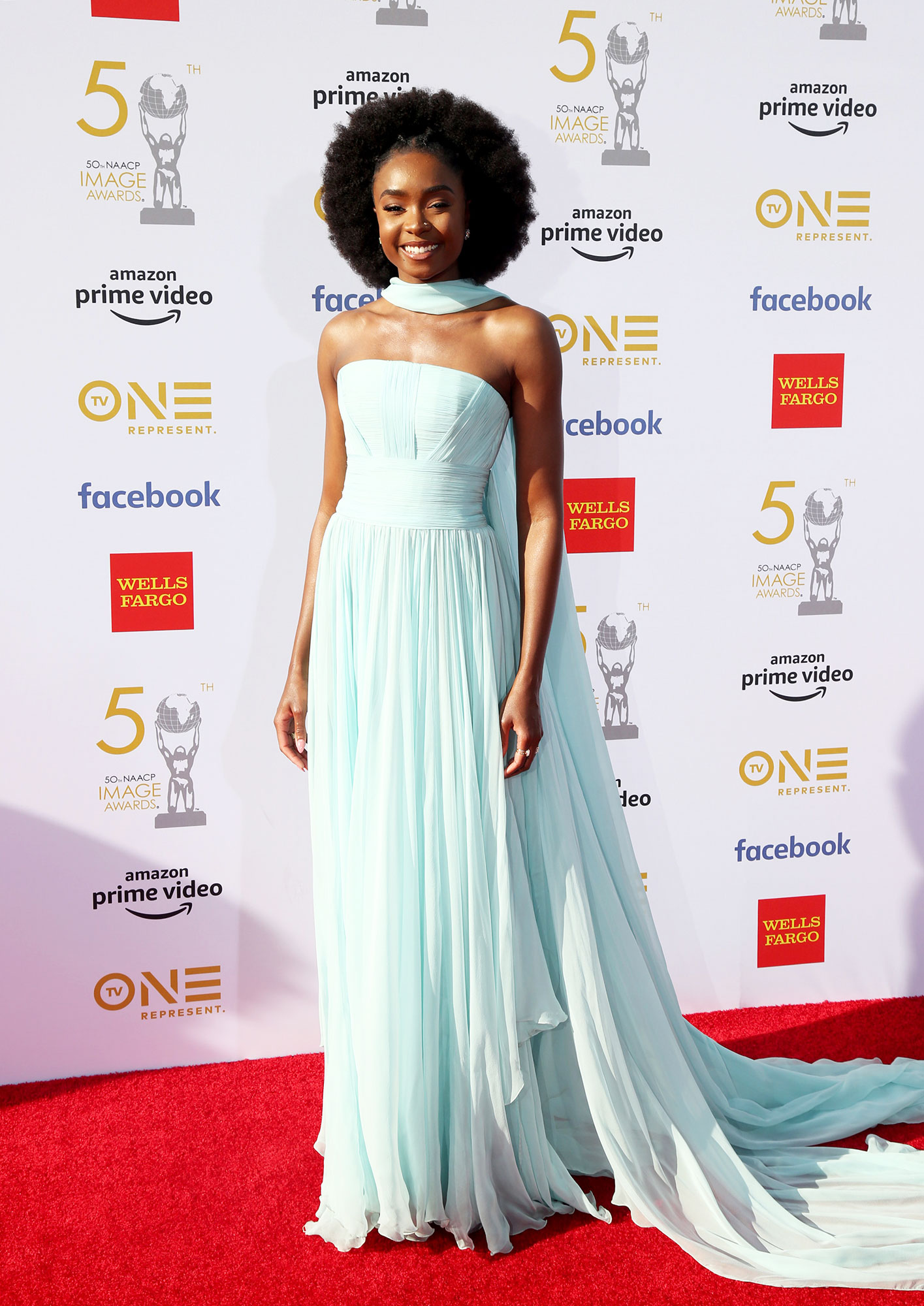 Kiki Layne See the Stars at the NAACP Image Awards - Wearing a robin's egg blue Georges Chakra strapless chiffon gown and scarf with Nicholas Kirkwood shoes.