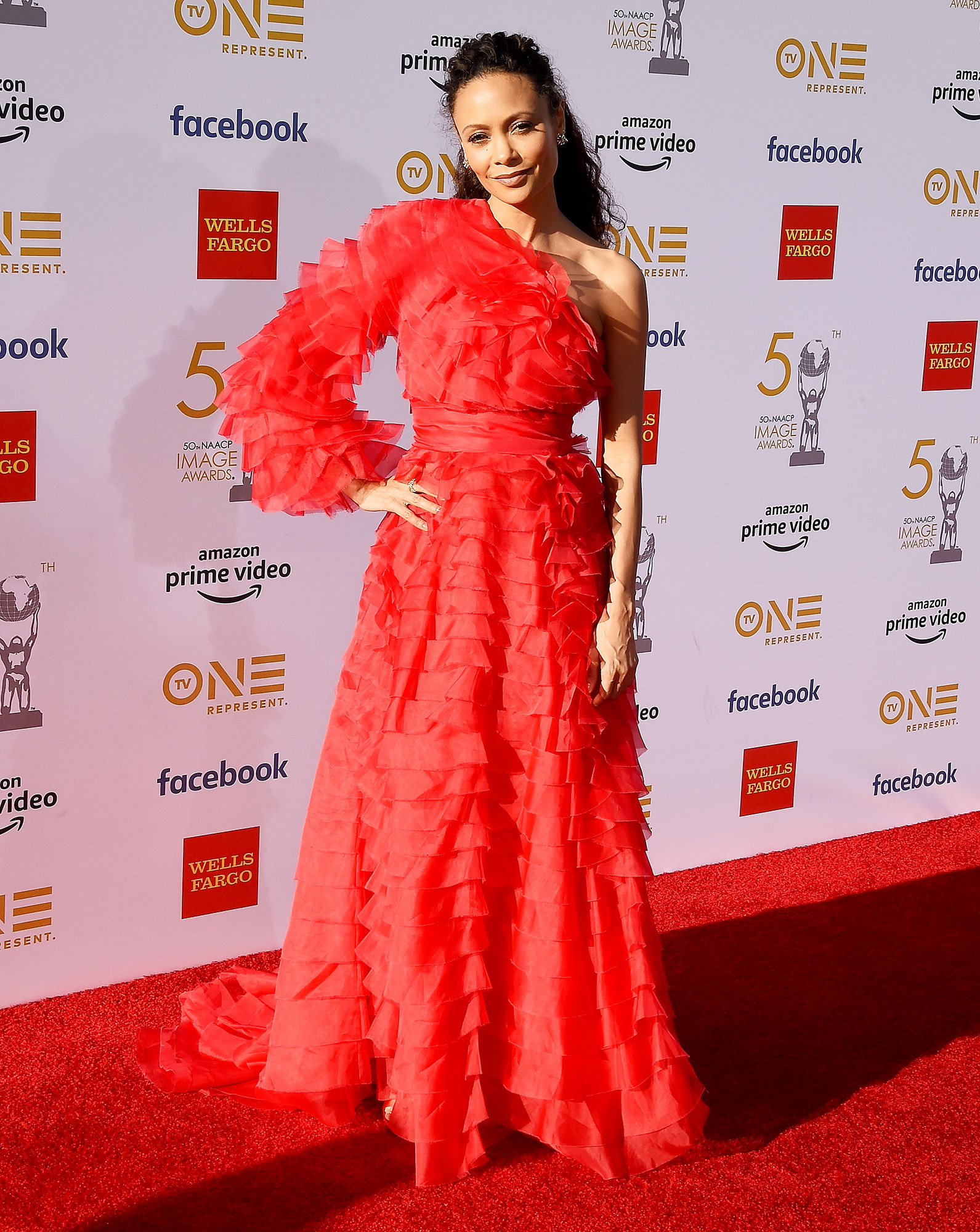 Thandie Newton See the Stars at the NAACP Image Awards - Wearing a ruffled asymmetrical Valentino gown.