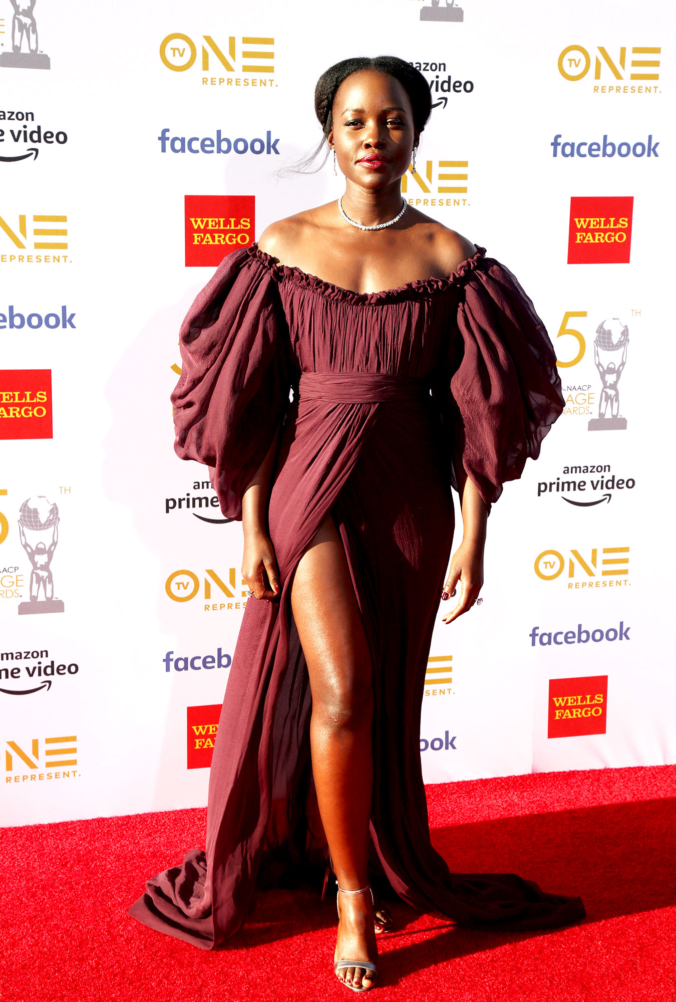 Lupita Nyong'o See the Stars at the NAACP Image Awards - Wearing an off-the-shoulder Giambattista Valli gown with a thigh-high slit.
