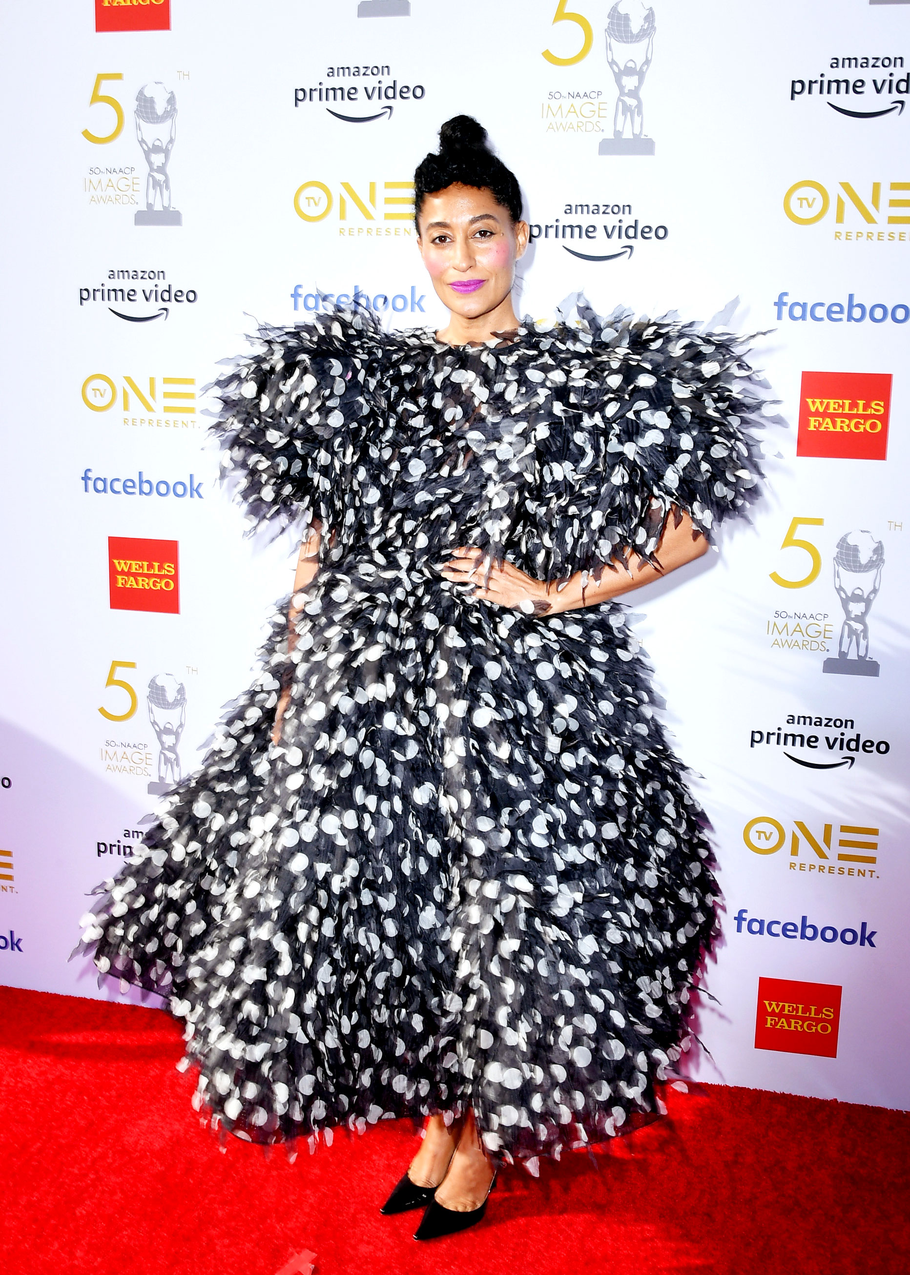 Tracee Ellis Ross See the Stars at the NAACP Image Awards - Wearing a black and white polka dot Marc Jacobs tea-length number.