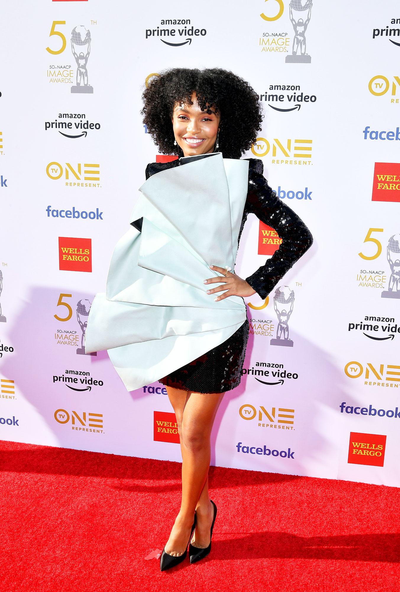Yara Shahidi See the Stars at the NAACP Image Awards - Wearing a black sequined Balmain mini with Brian Atwood pumps.