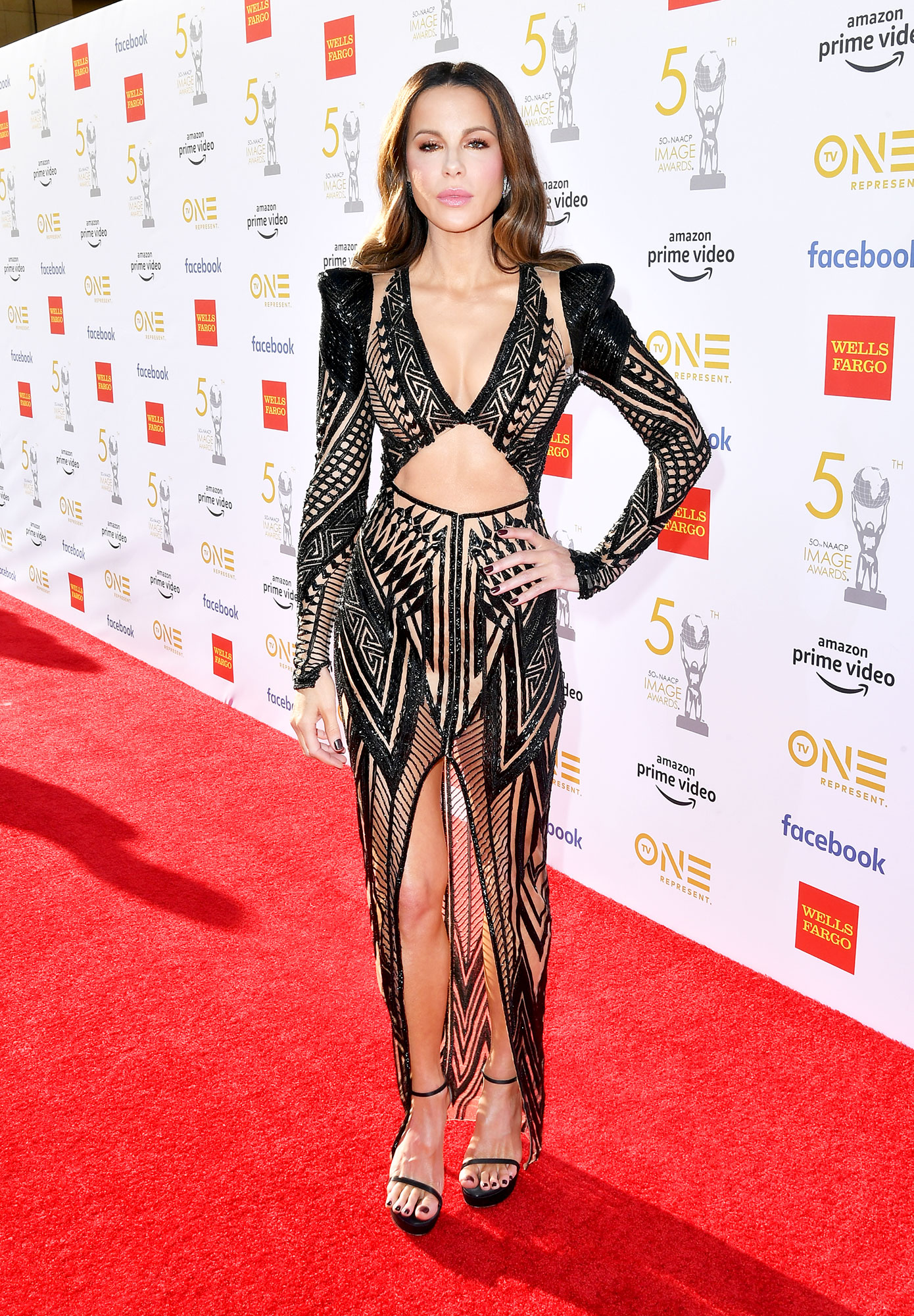 Kate Beckinsale See the Stars at the NAACP Image Awards - Wearing a nearly naked Julien MacDonald gown with Stuart Weitzman heels.
