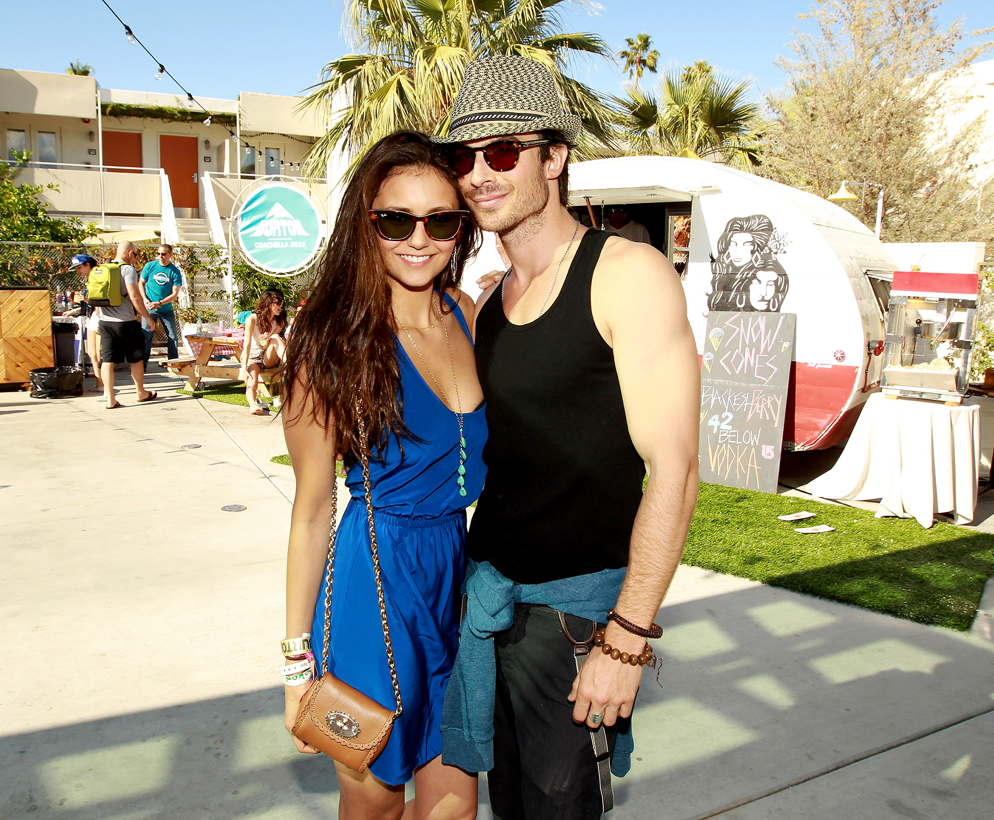 Nina-Dobrev-and-Ian-Somerhalder-coachella - The Vampire Diaries costars flexed their fit arms at a Coachella pool party and barbecue in 2012.