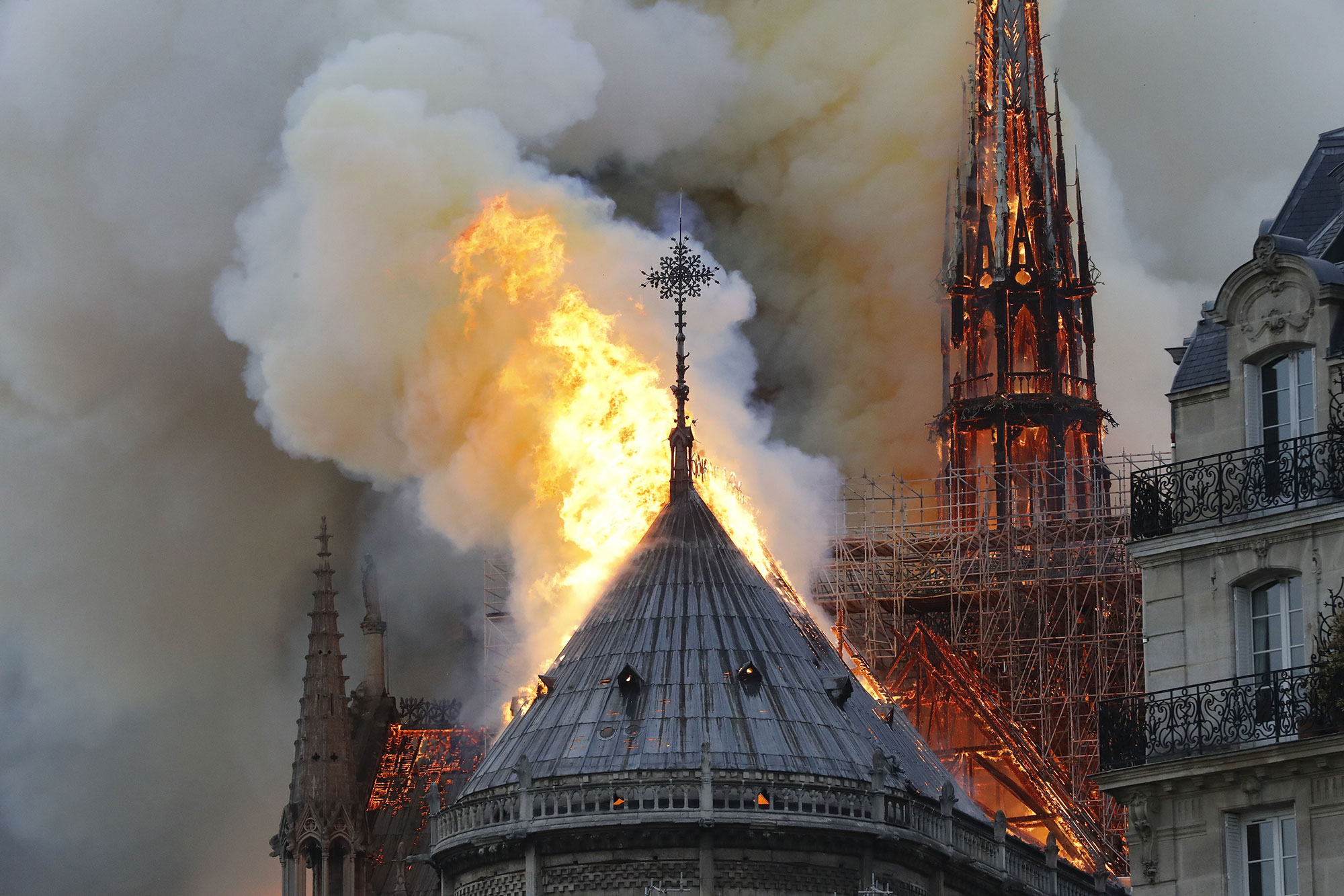 Notre Dame on Fire - Flames and smoke are seen billowing from the roof at Notre-Dame Cathedral April 15, 2019 in Paris, France.