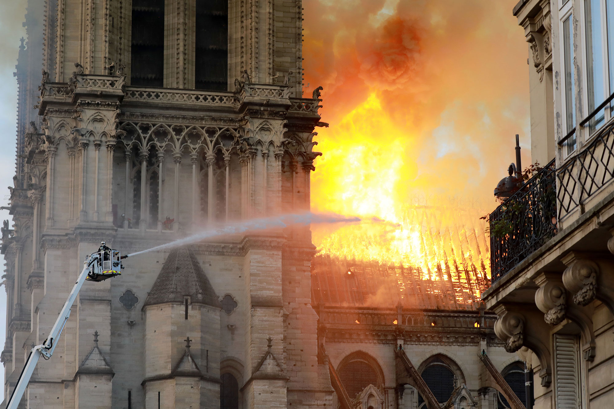 Notre Dame on Fire - A firefighter is seen fighting the flames at Notre-Dame Cathedral April 15, 2019 in Paris, France.