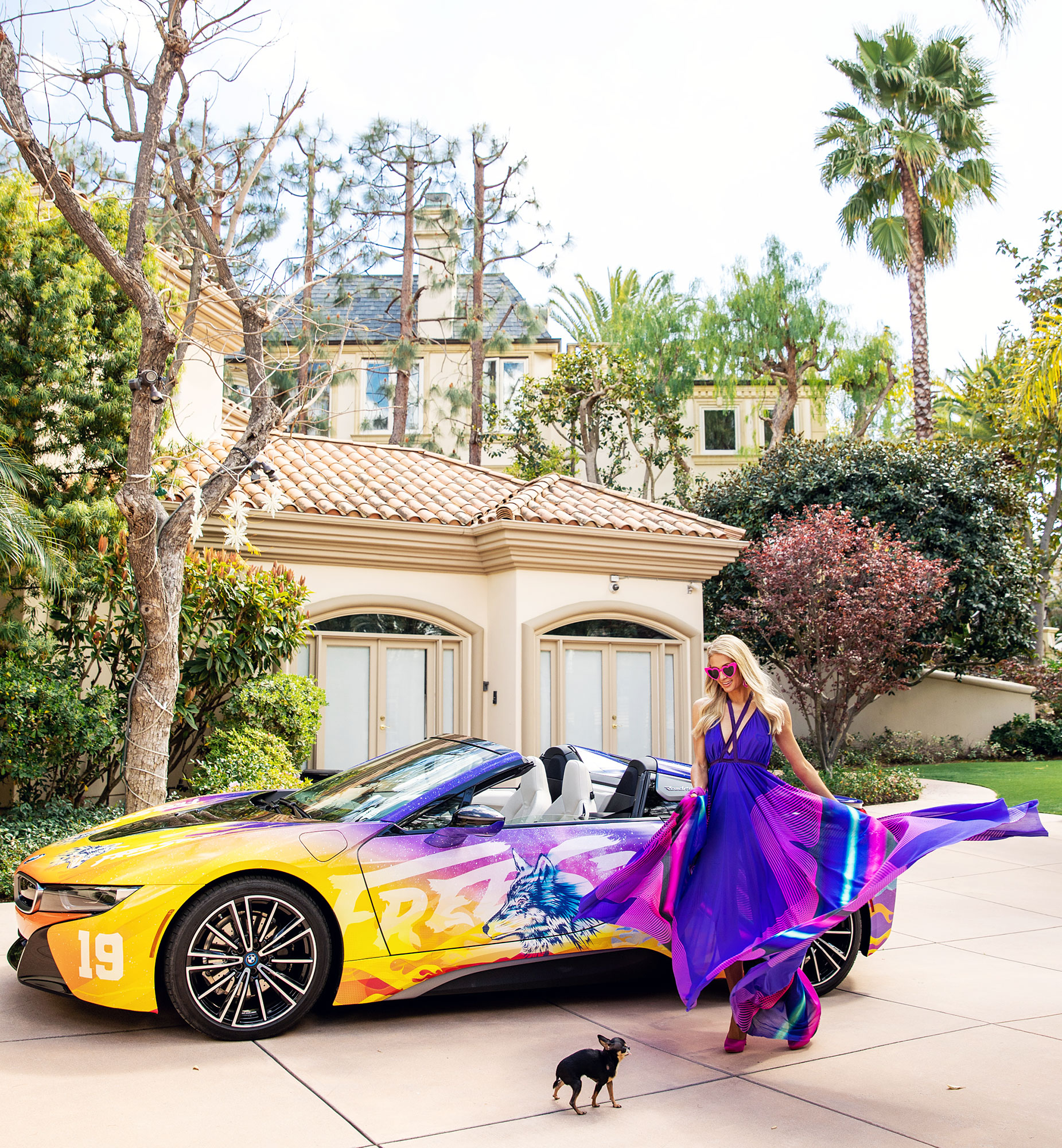 Paris Hilton BMWi8 Coachella - The socialite showed off her fab figure as she color-coordinated with her custom wrapped BMWi8 ride to Coachella, produced by Mirrored Media.