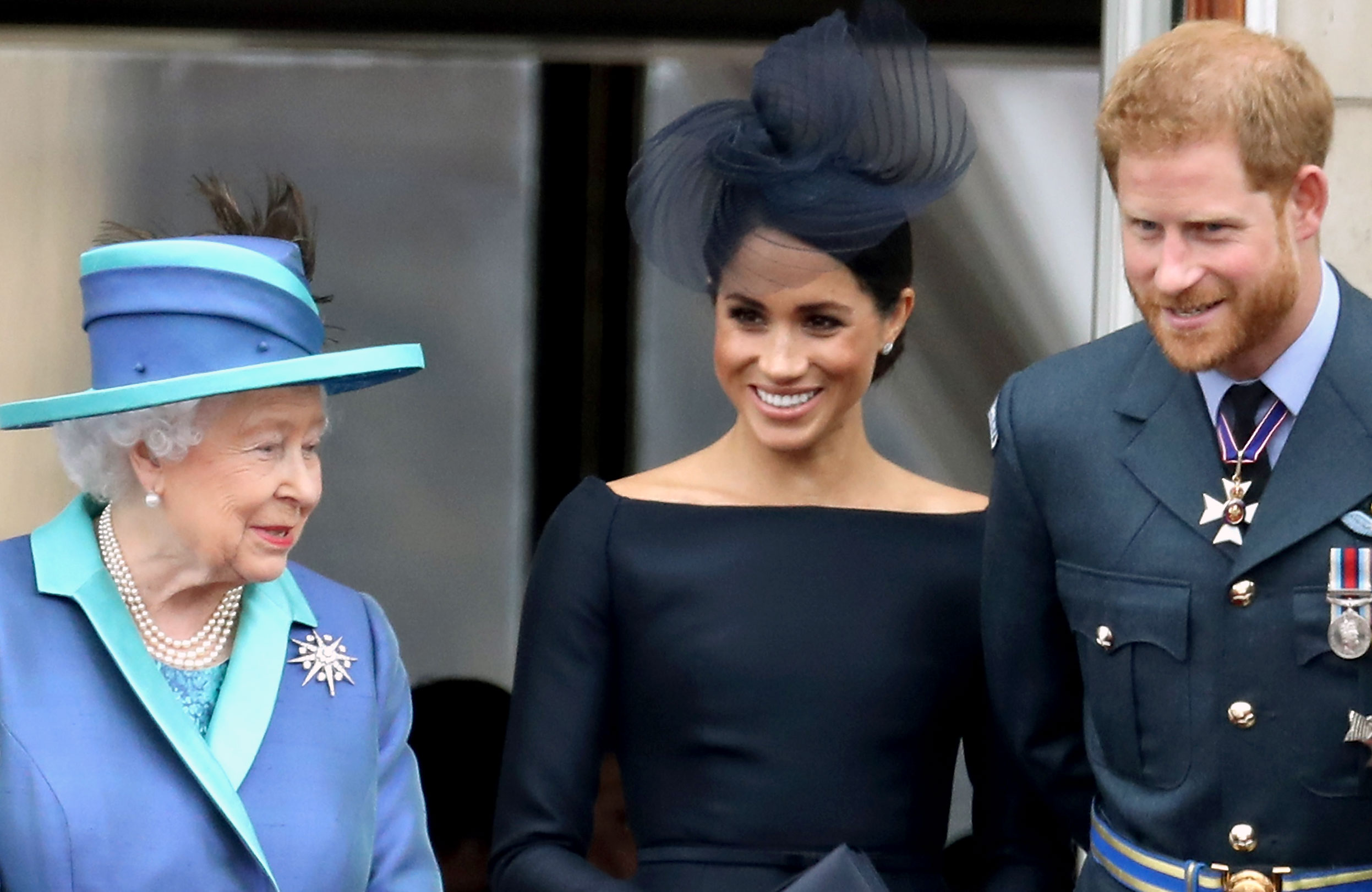 Prince Harry Duchess Meghan Wish Queen Elizabeth Happy 93rd Birthday - Queen Elizabeth II, Meghan, Duchess of Sussex, Prince Harry, Duke of Sussex watch the RAF flypast on the balcony of Buckingham Palace, as members of the Royal Family attend events to mark the centenary of the RAF on July 10, 2018 in London, England.