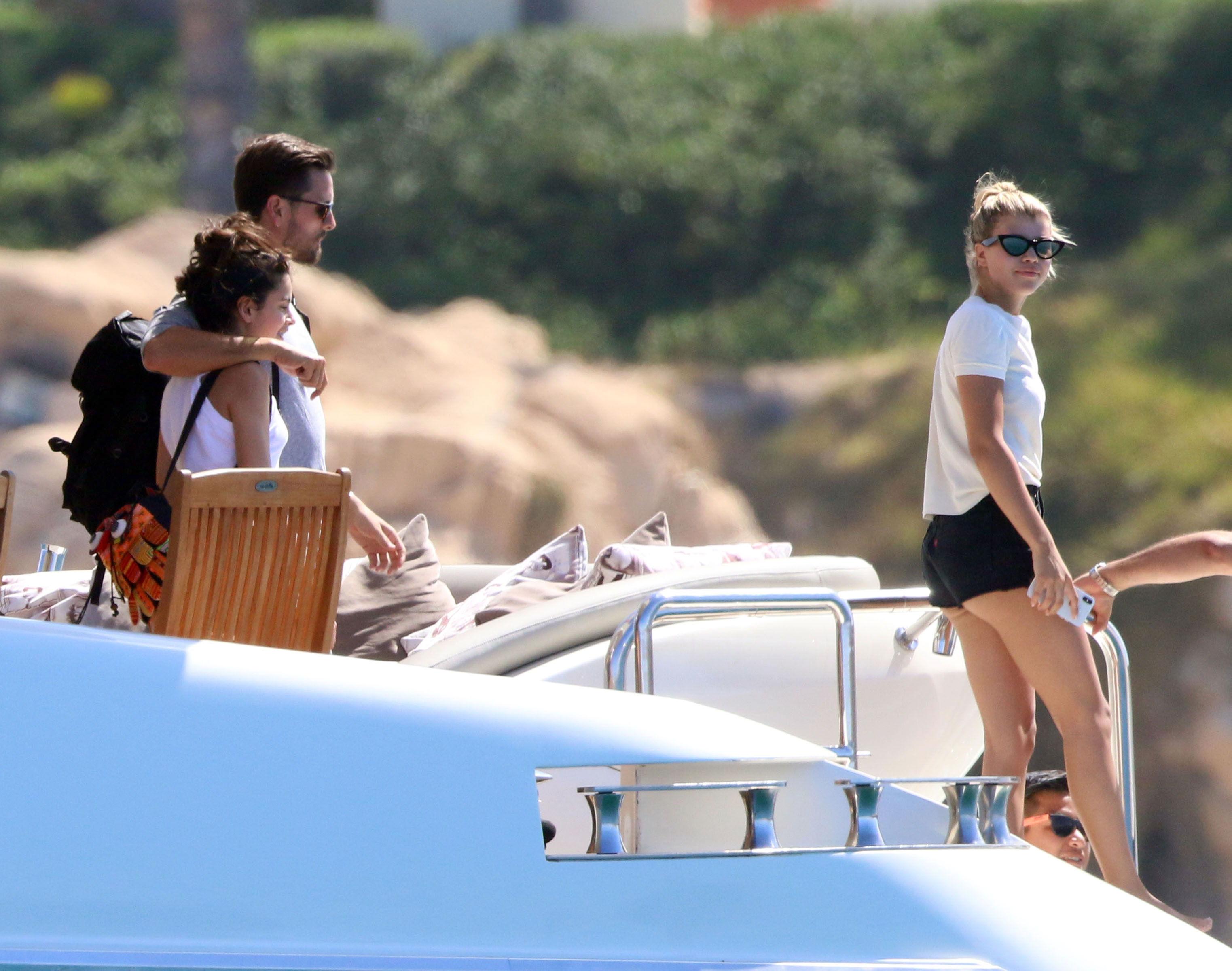 Scott Disick Sofia Richie vacation in Mexico - The reality star wrapped his arm around a female friend as they stepped off the boat.