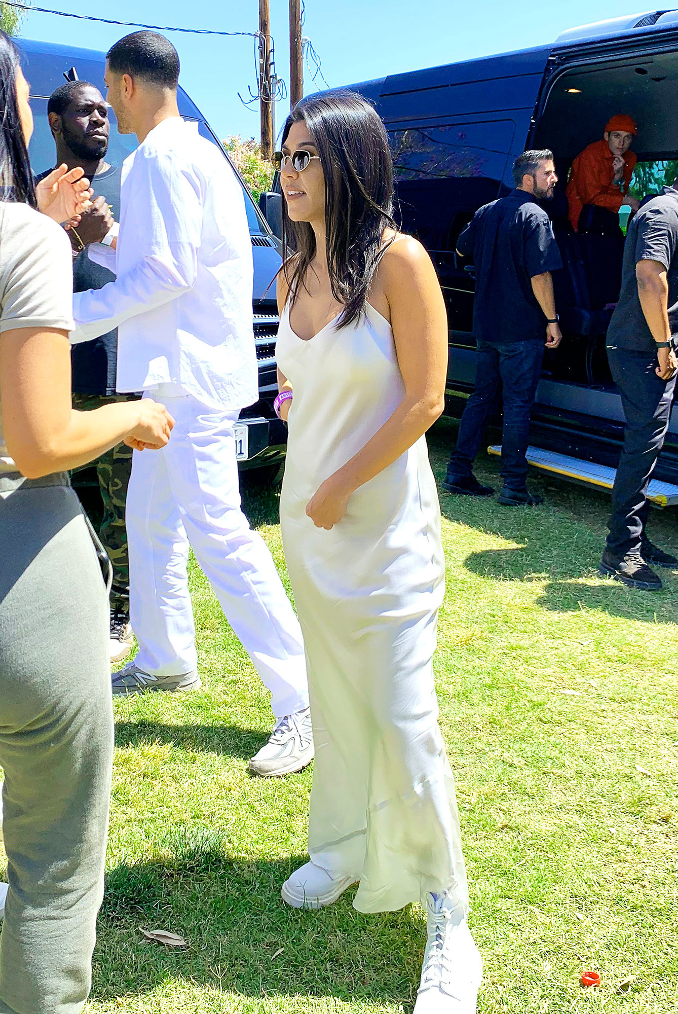 coachella 2019 style weekend 2 Kendall Jenner, Kourtney Kardashian - The mom-of-three dressed down her white satin maxidress with a pair of matching combat boots on Sunday, April 21.