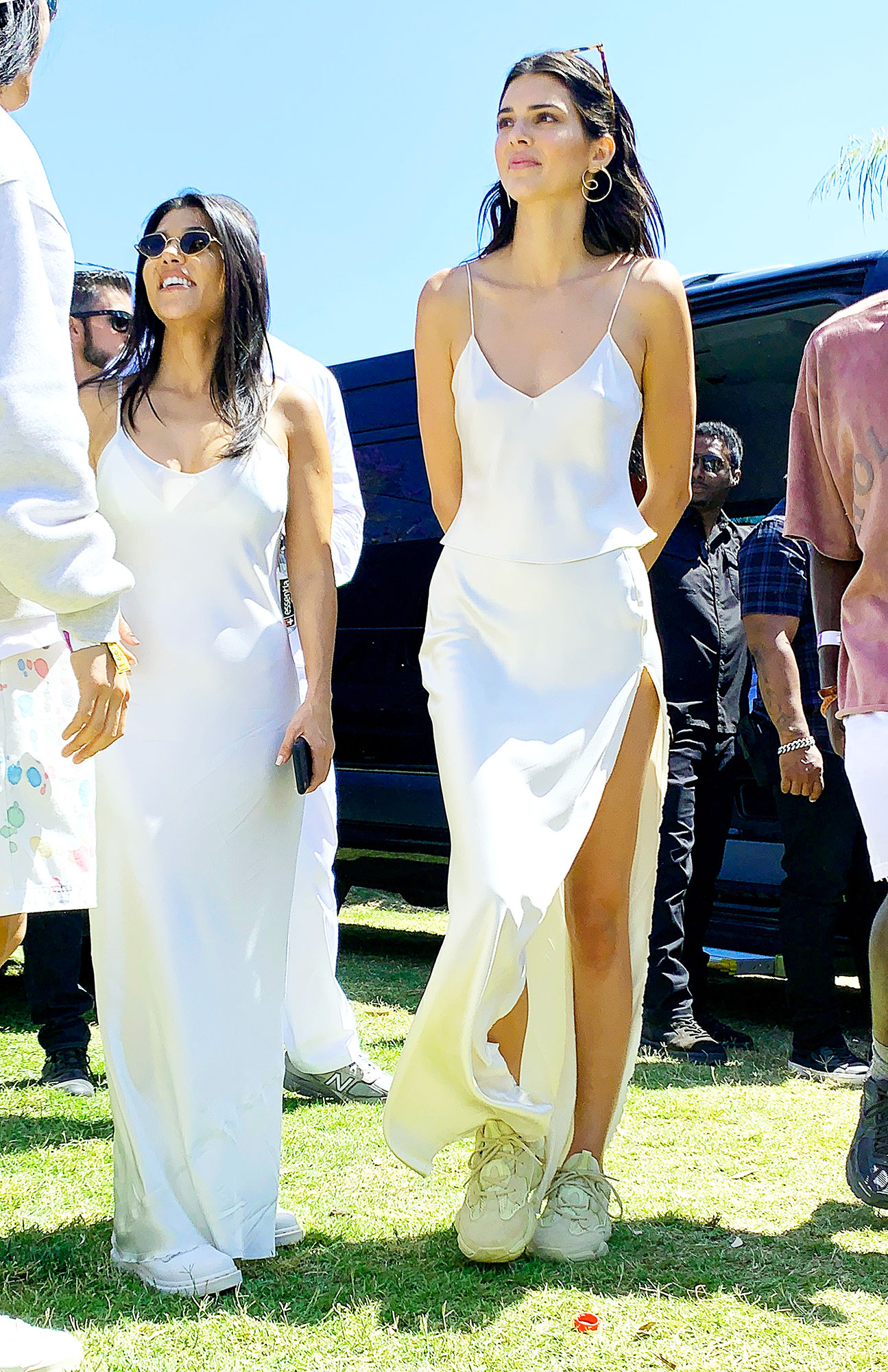 coachella 2019 style weekend 2 Kendall Jenner, Kourtney Kardashian, - The supermodel showed some leg in a slitted white maxiskirt and matching cami on Sunday, April 21.