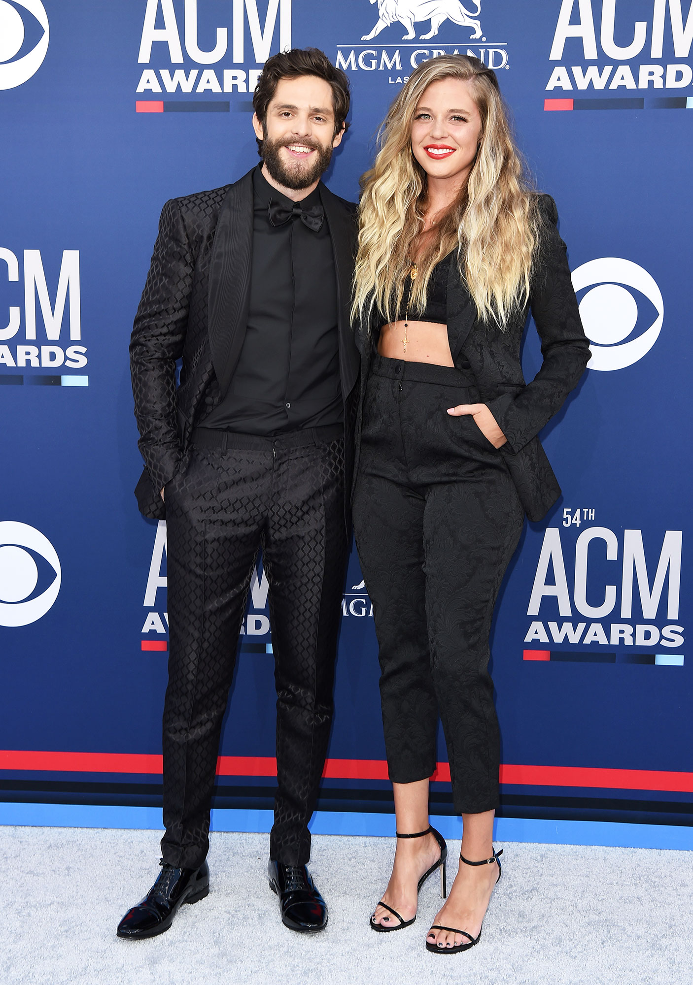 Thomas Rhett and Lauren Akins Smoking Hot Couples Style at the ACMs - One of country music's cutest duos proved that the couple that dresses together strays together in Dolce and Gabbana.