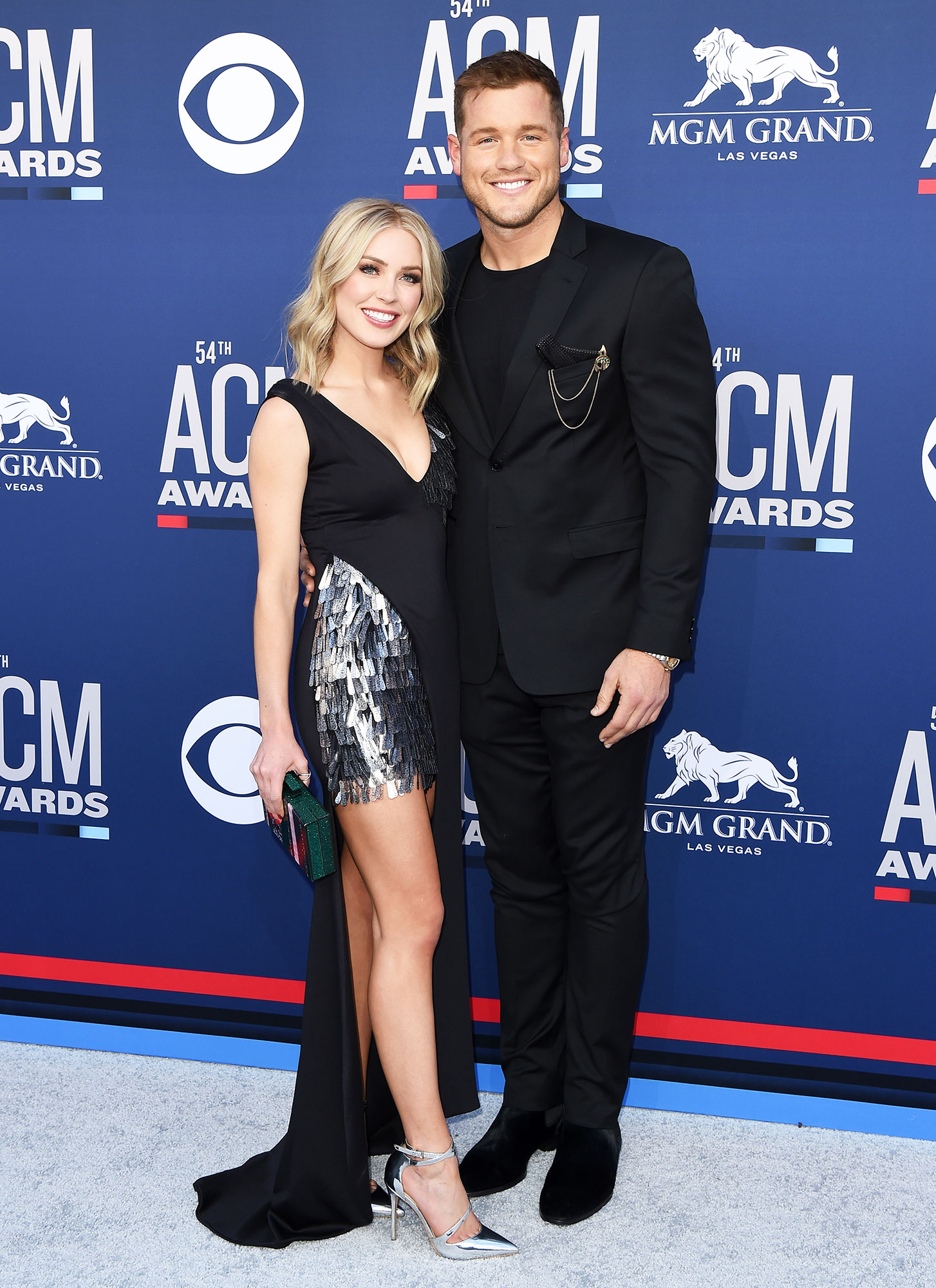 Smoking Hot Couples Style at the ACMs - The Bachelor alums looked like the perfect pair (sartorially speaking!) on the red carpet with Randolph in an asymmetrical Hamel gown, Aldo heels and Asos clutch and Underwood in an all-black-everything Ted Baker suit and To Boot New York shoes combo.