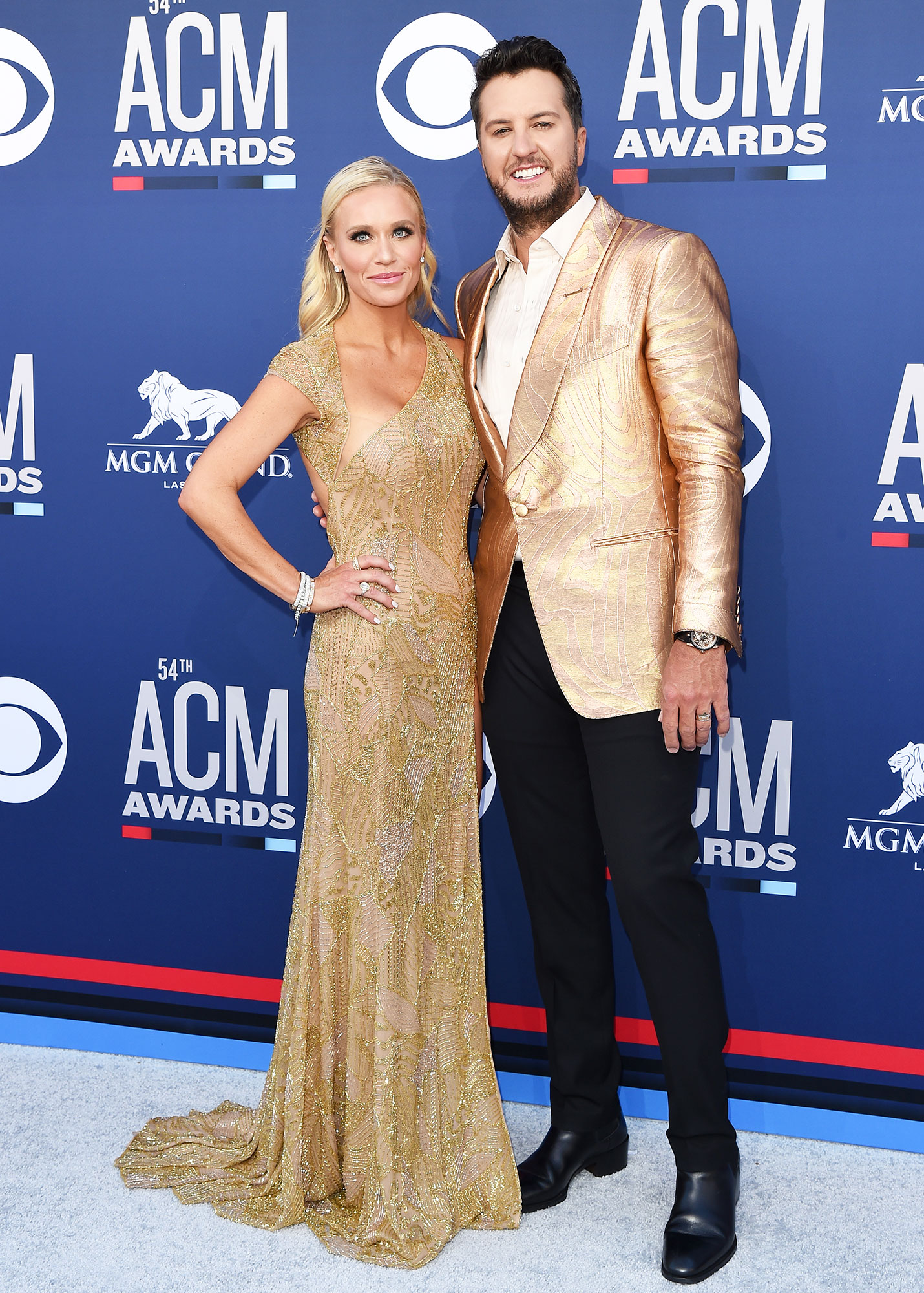 Caroline Boyer and Luke Bryan Smoking Hot Couples Style at the ACMs - The husband and wife duo were going for the gold in their matching metallic looks.