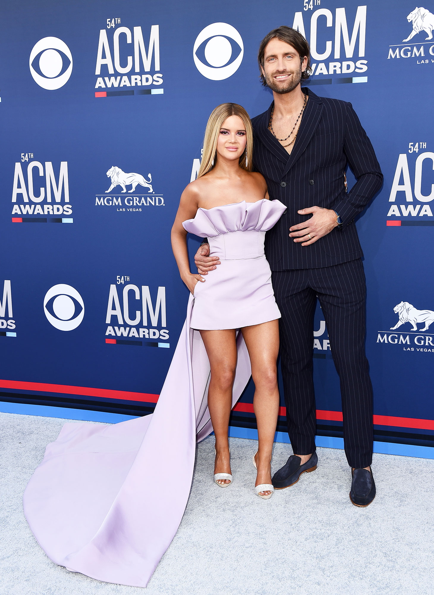 Maren Morris and Ryan Hurd Smoking Hot Couples Style at the ACMs - Showing off their fun fashion sense, the songstress kept things short and sweet in a lavender Christian Siriano mini, while her hubby rocked a pinstriped double-breasted suit.