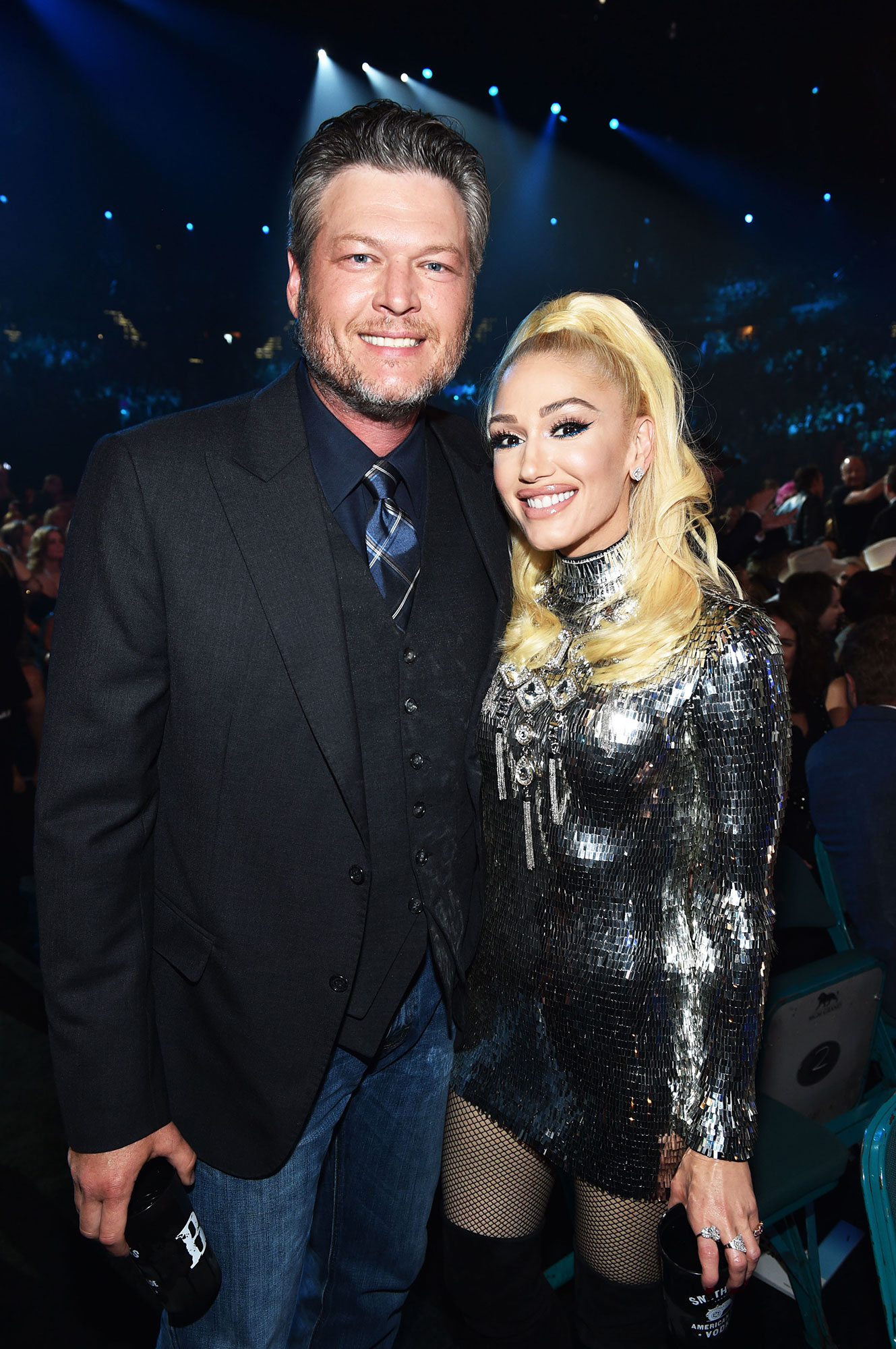 Blake Shelton and Gwen Stefani Smoking Hot Couples Style at the ACMs - While the lovebirds didn't walk the red carpet, they did pose inside. Shelton dressed up his jeans with a suit, vest and tie, while Stefani sparkled in a silver mini.