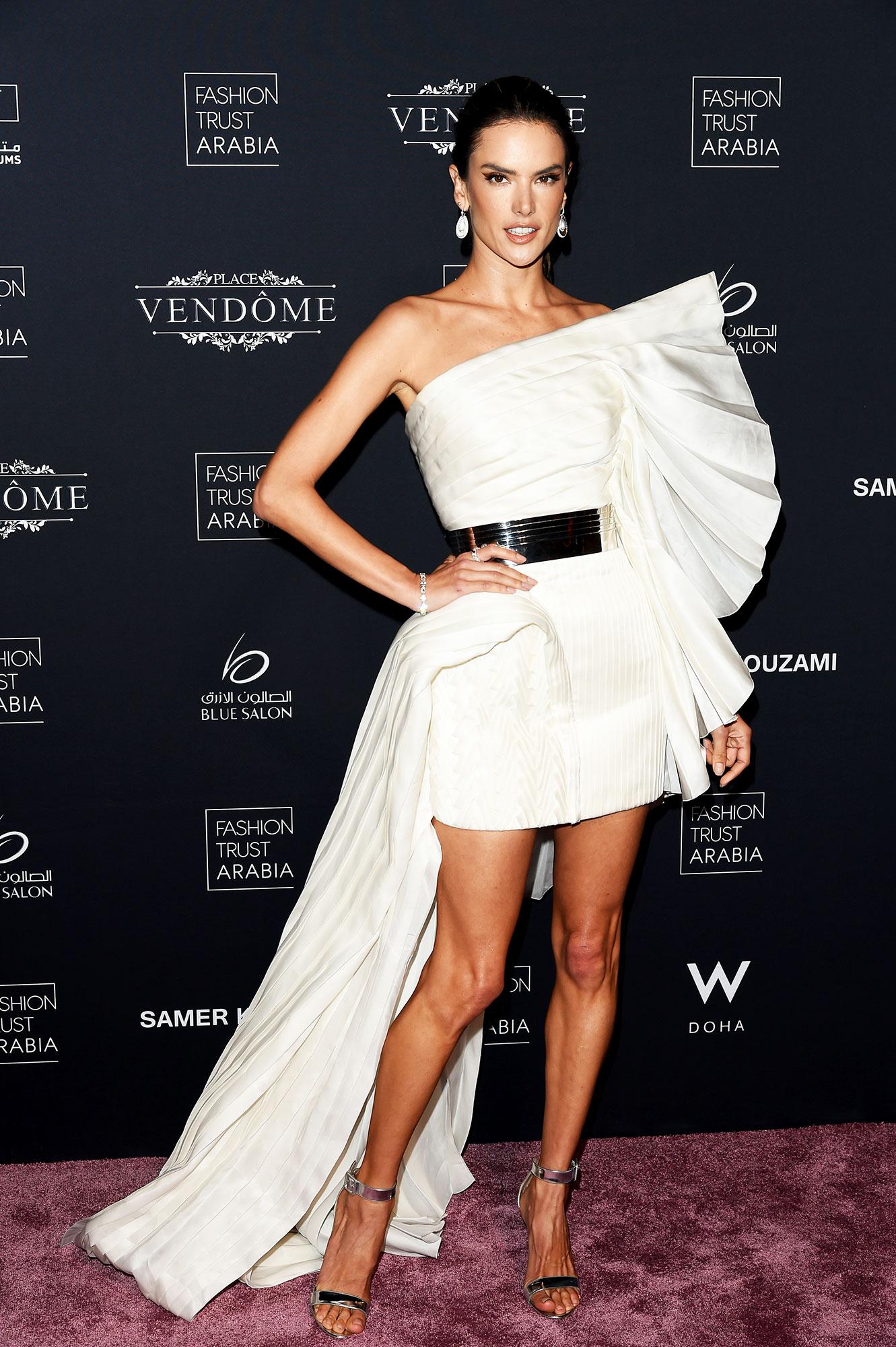 Alessandra Ambrosio stylish - In a $55,295 pleated silk Balmain on March 28.
