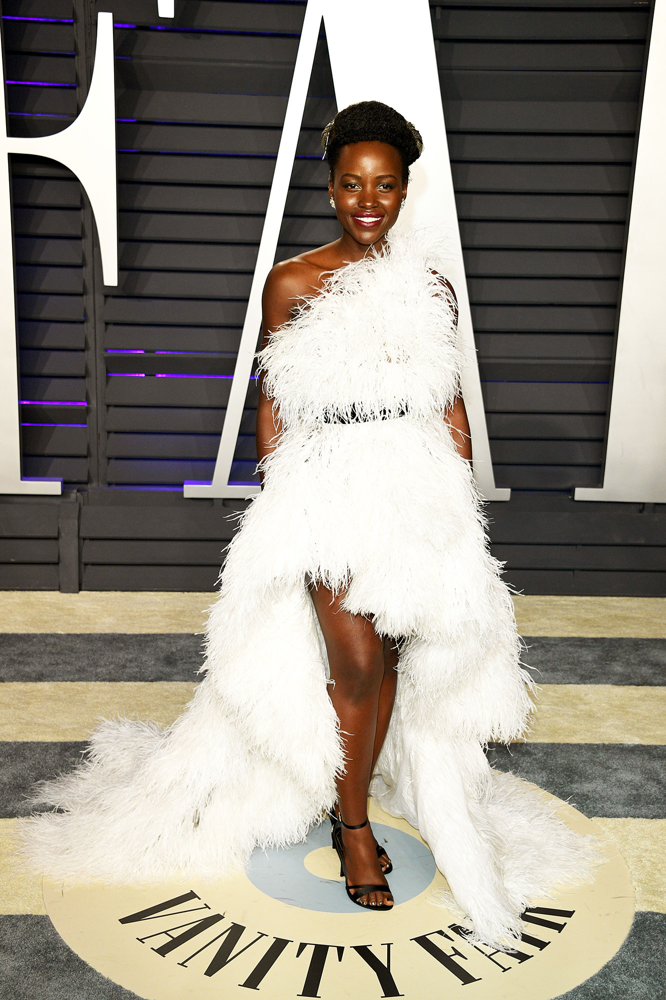 Lupita Nyong'o stylish - In an ostrich-feather Oscar de la Renta on Feb. 24.