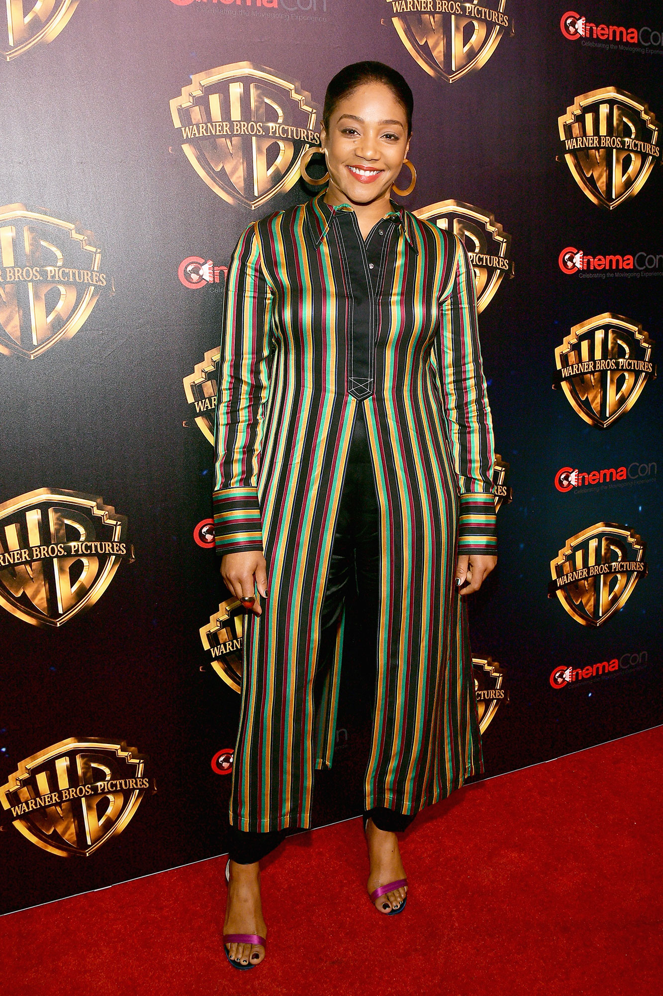 Tiffany Haddish The Stars Are Bringing Their Style A-Game to CinemaCon - The funny lady showed her stripes in a multi-colored tunic and hot pink sandals on Tuesday, April 2.