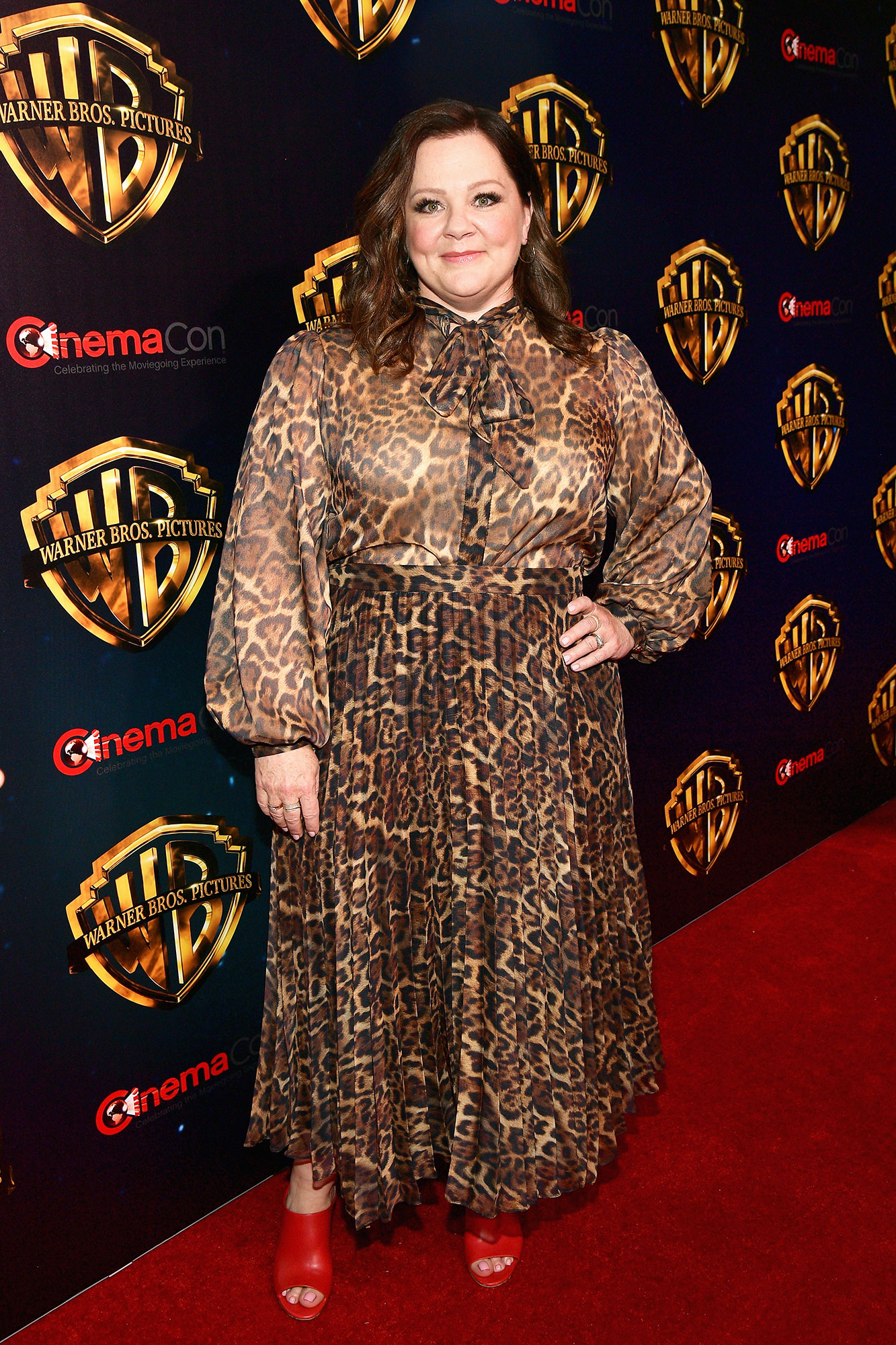 Melissa McCarthy The Stars Are Bringing Their Style A-Game to CinemaCon - We love that pop of color the actress added to her animal-print mididress in the form of bright red mules on Tuesday, April 2.